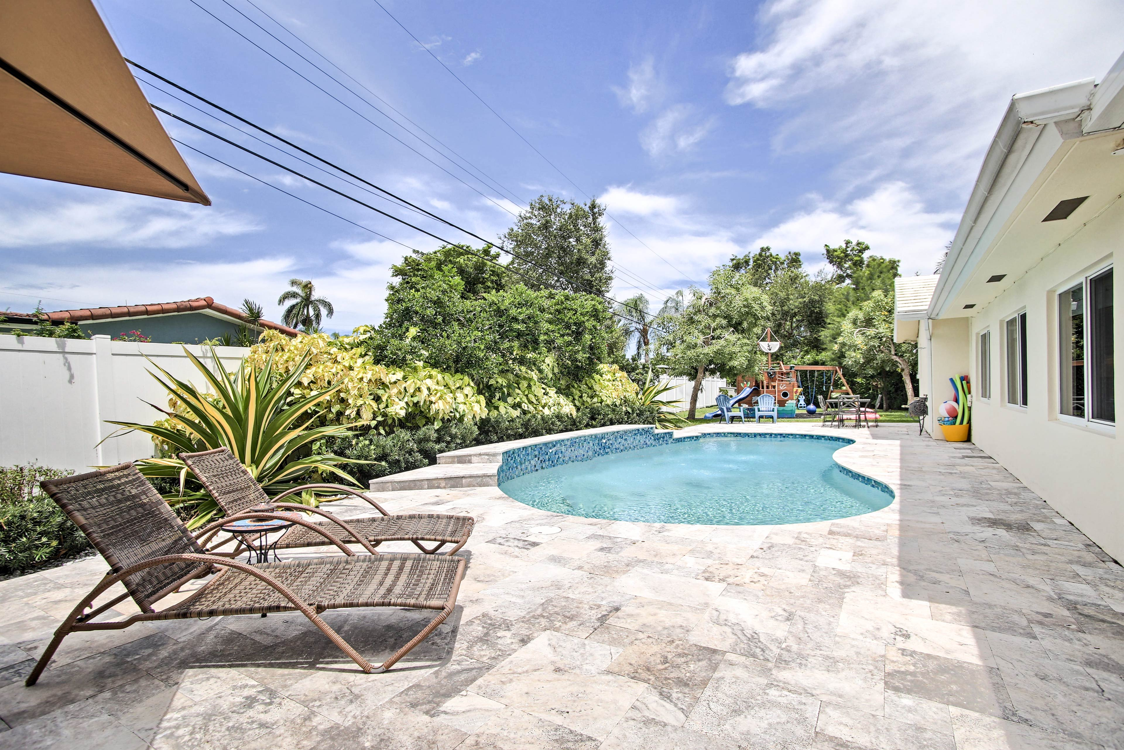 Dive into this stunning heated saltwater pool!