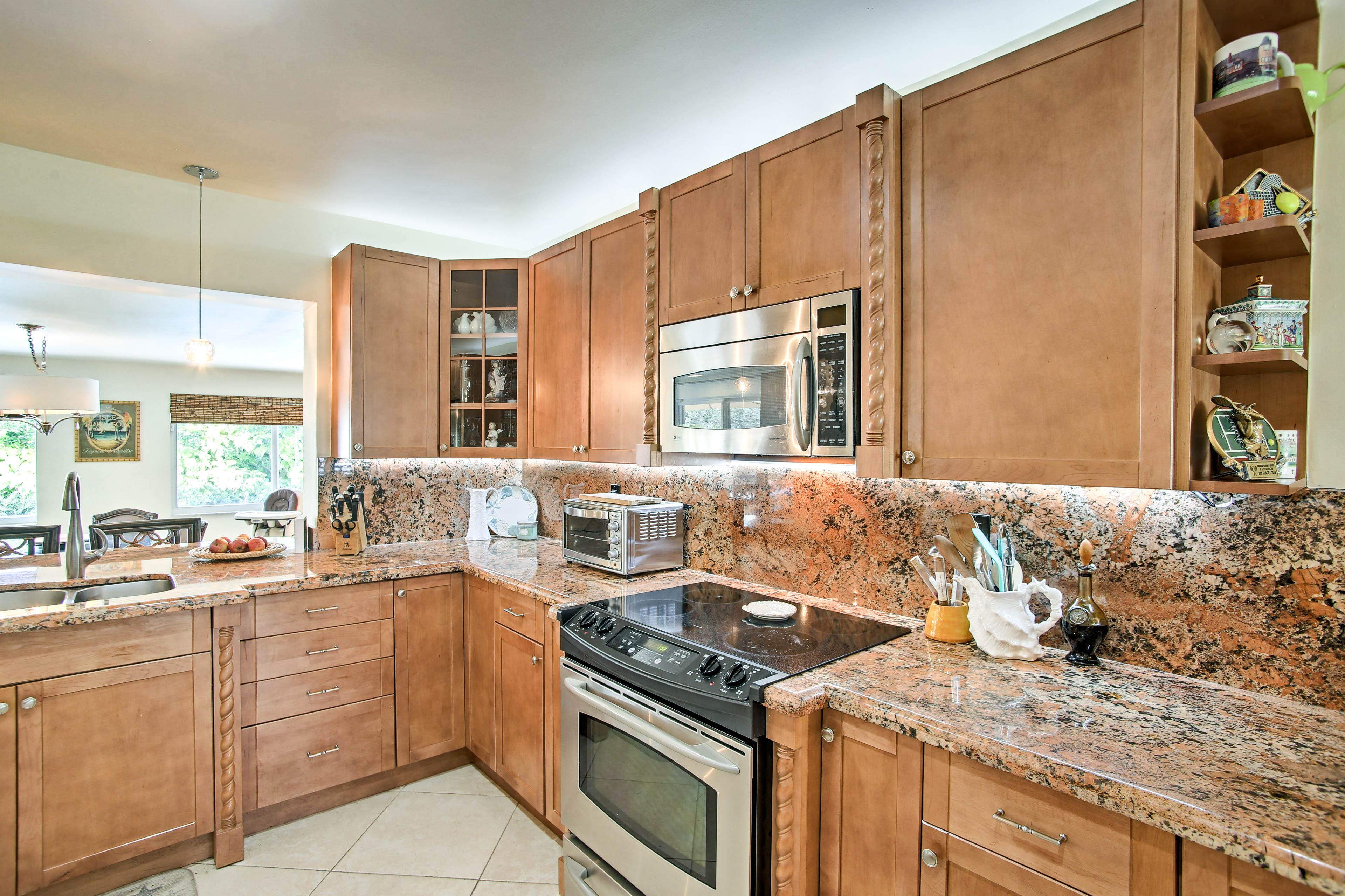 Modern appliances & granite countertops elevate your cooking experience.