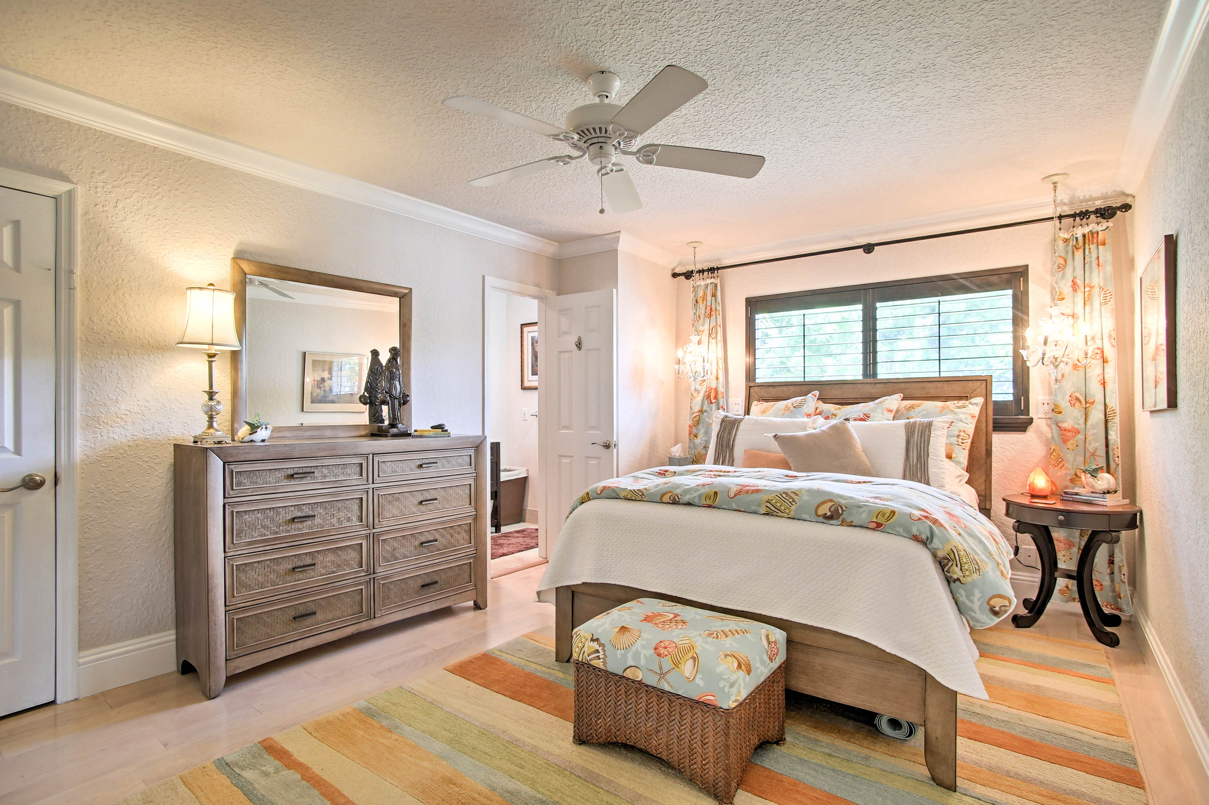 Retreat to the master bedroom for a sound night's sleep in the queen bed.
