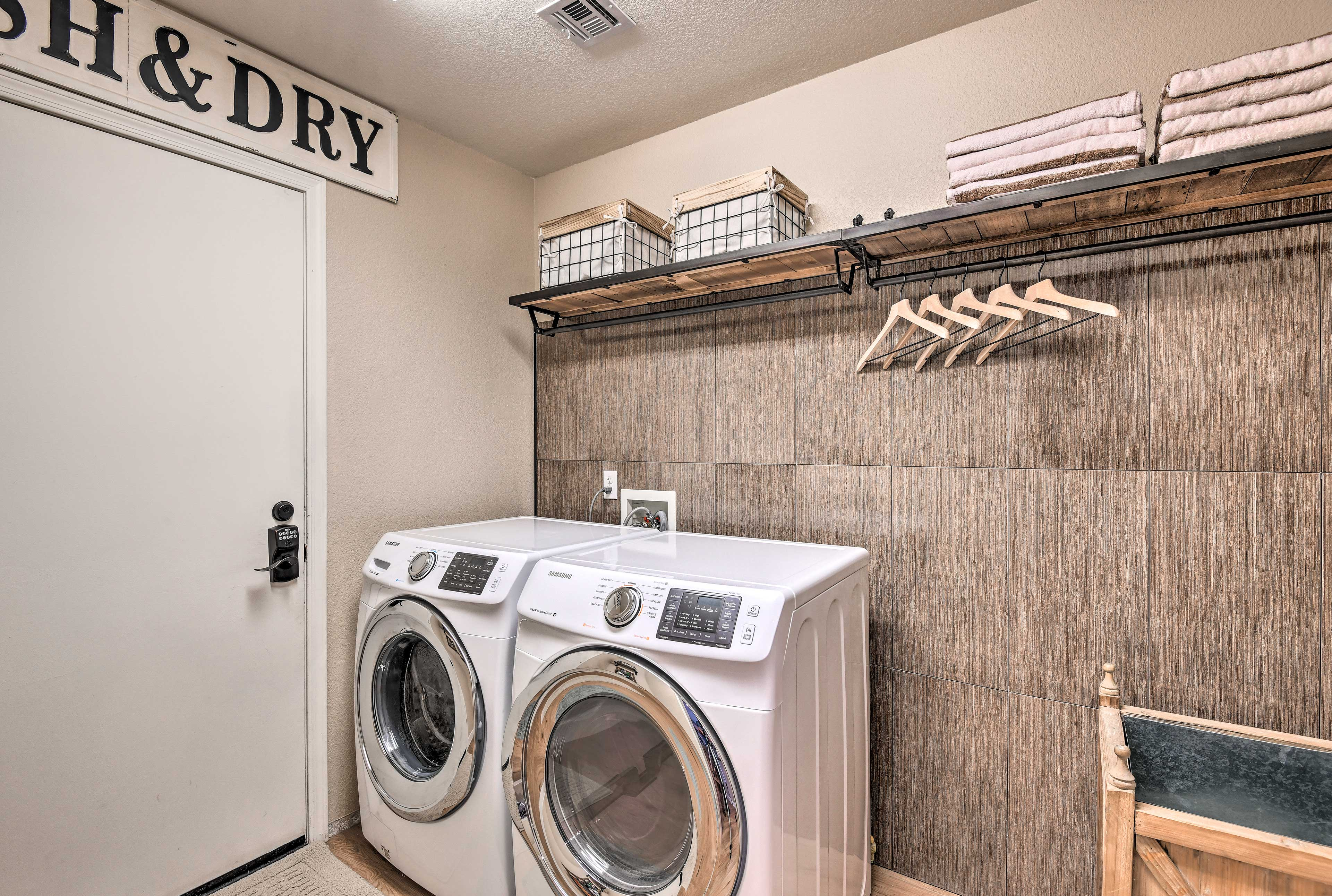 Toss your dirty clothes in the washer and dryer.
