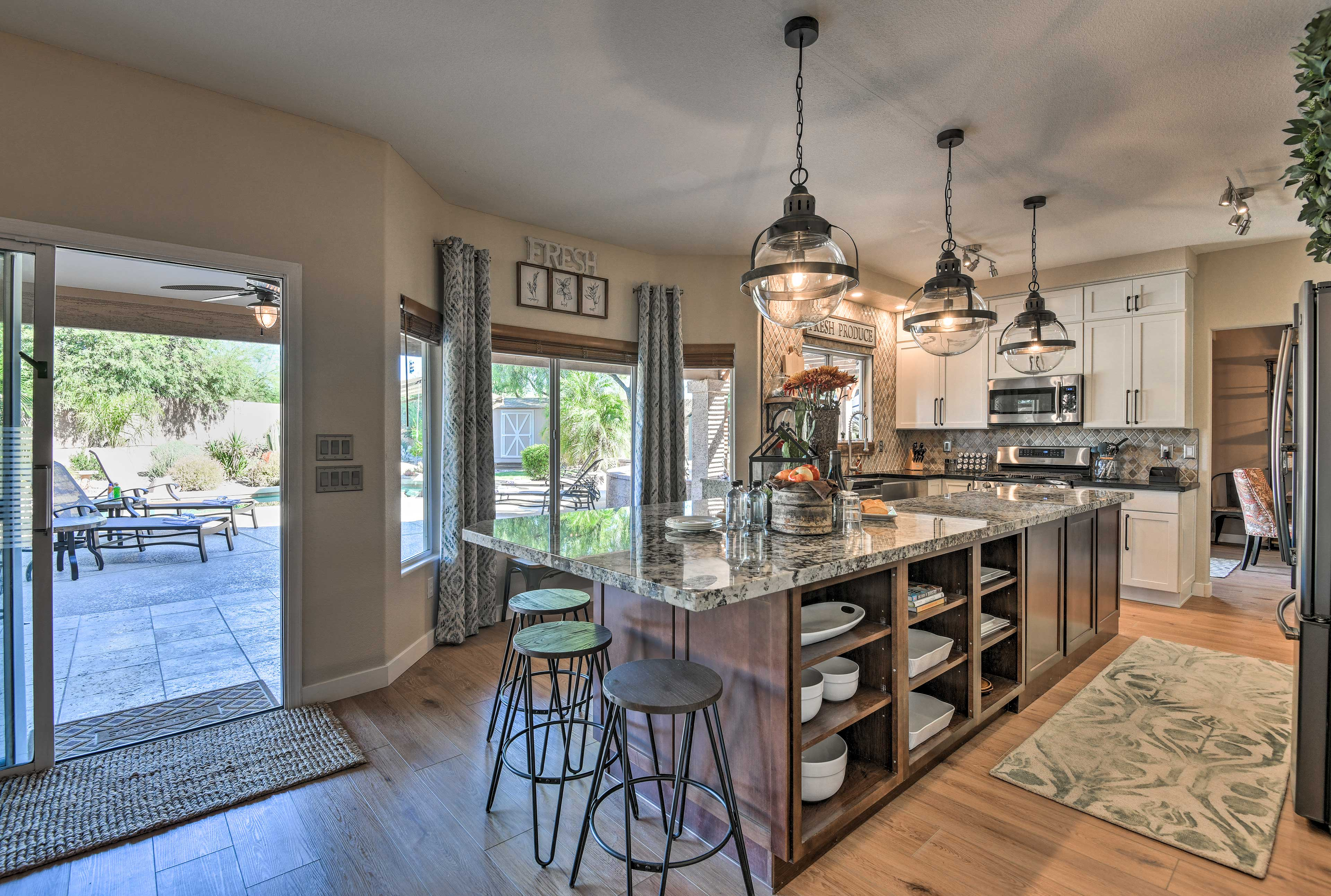 Take a few steps and find yourself in the fully equipped kitchen.