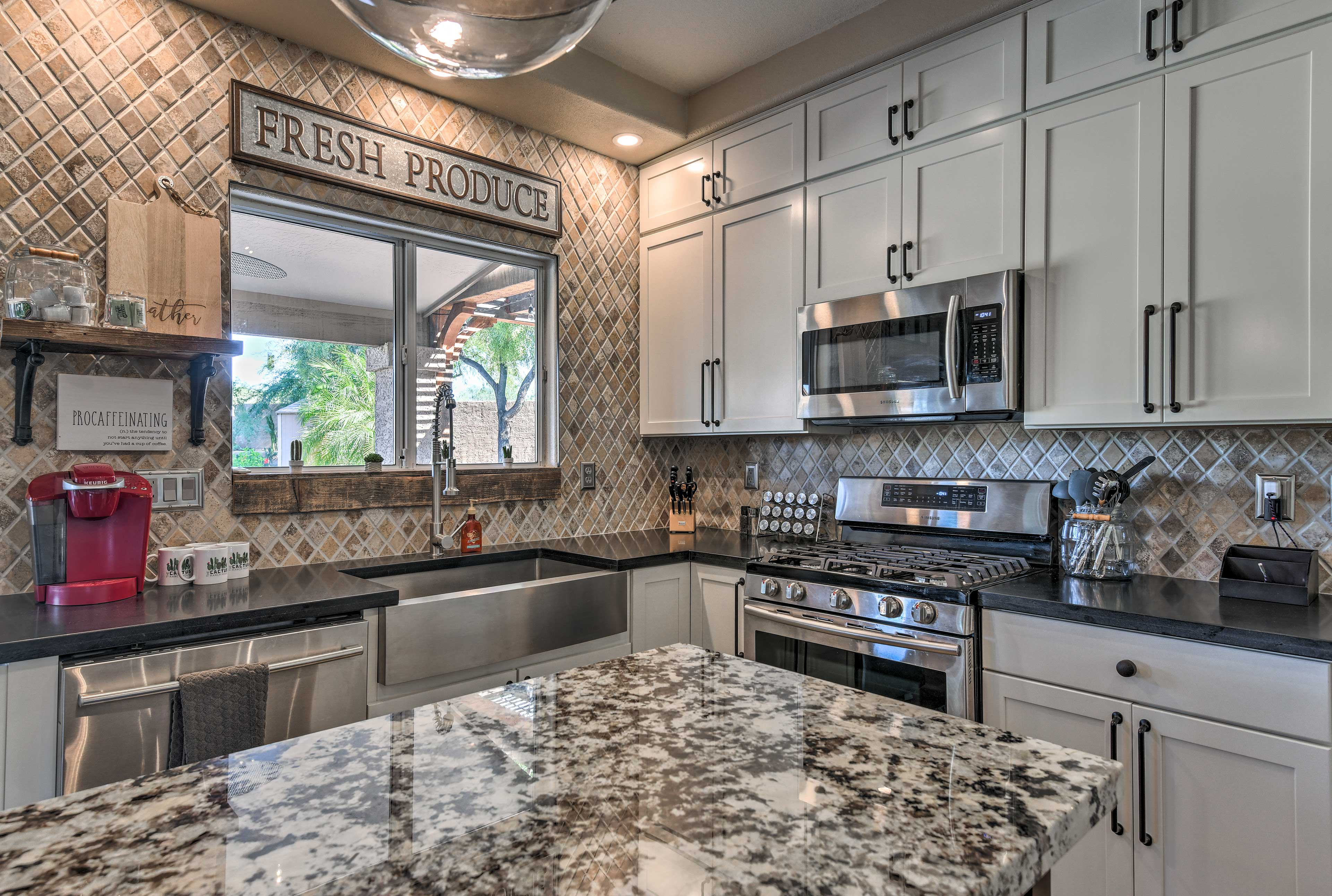 The kitchen offers stainless steel appliances.