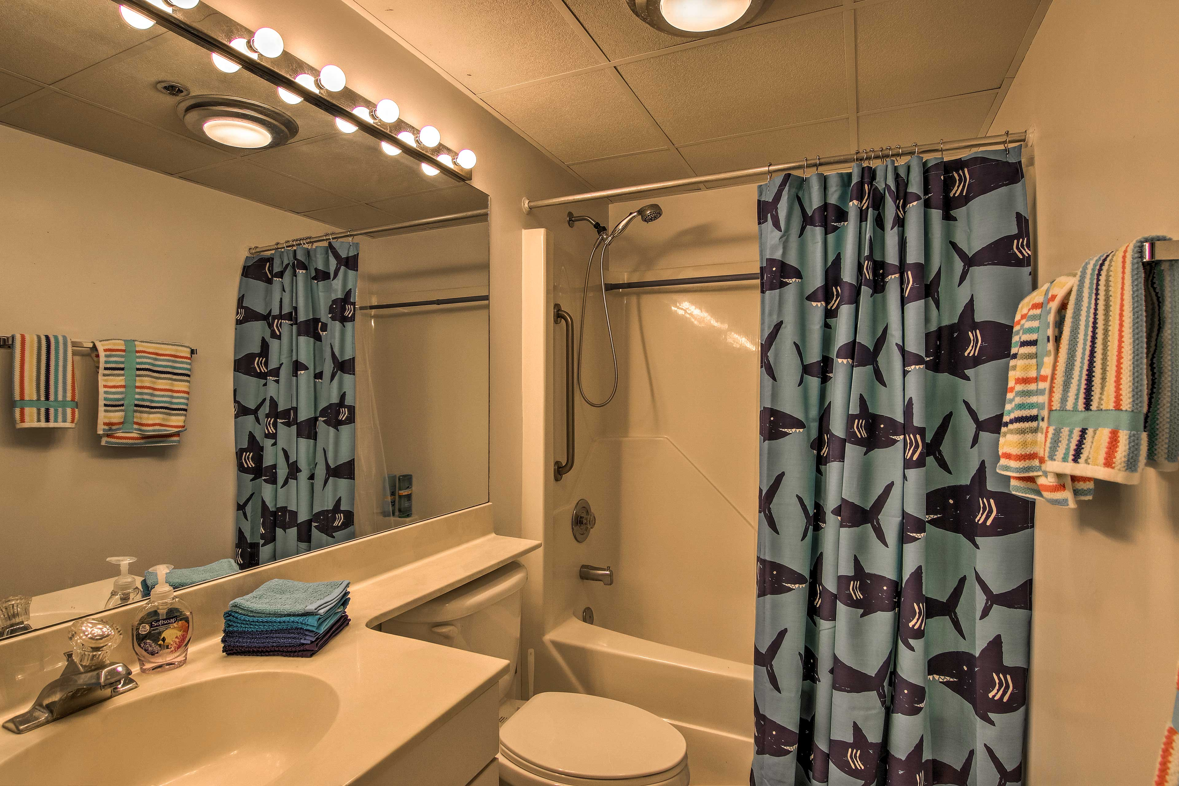 This bathroom also offers a shower/tub combo.