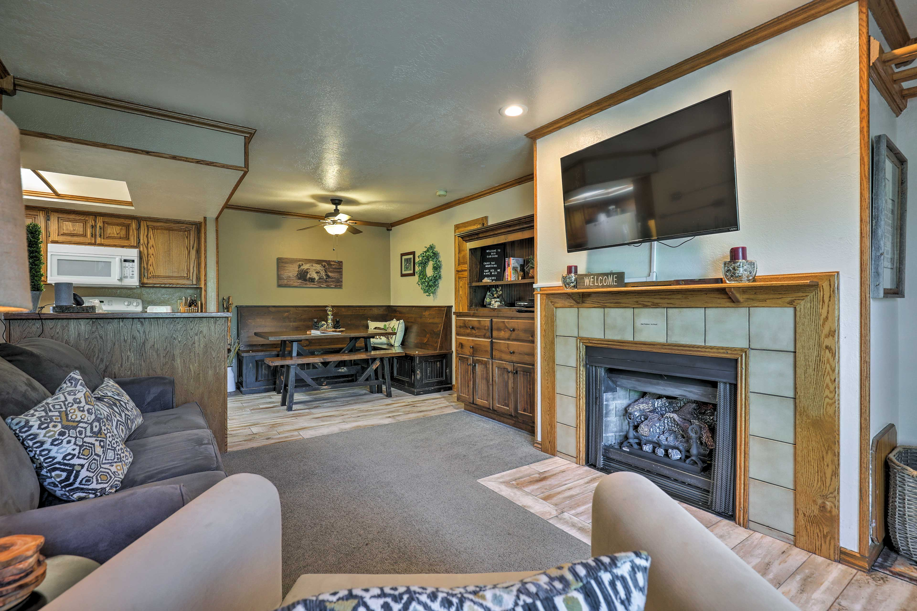 Turn on the gas fireplace and relax on the sofa while you watch TV.