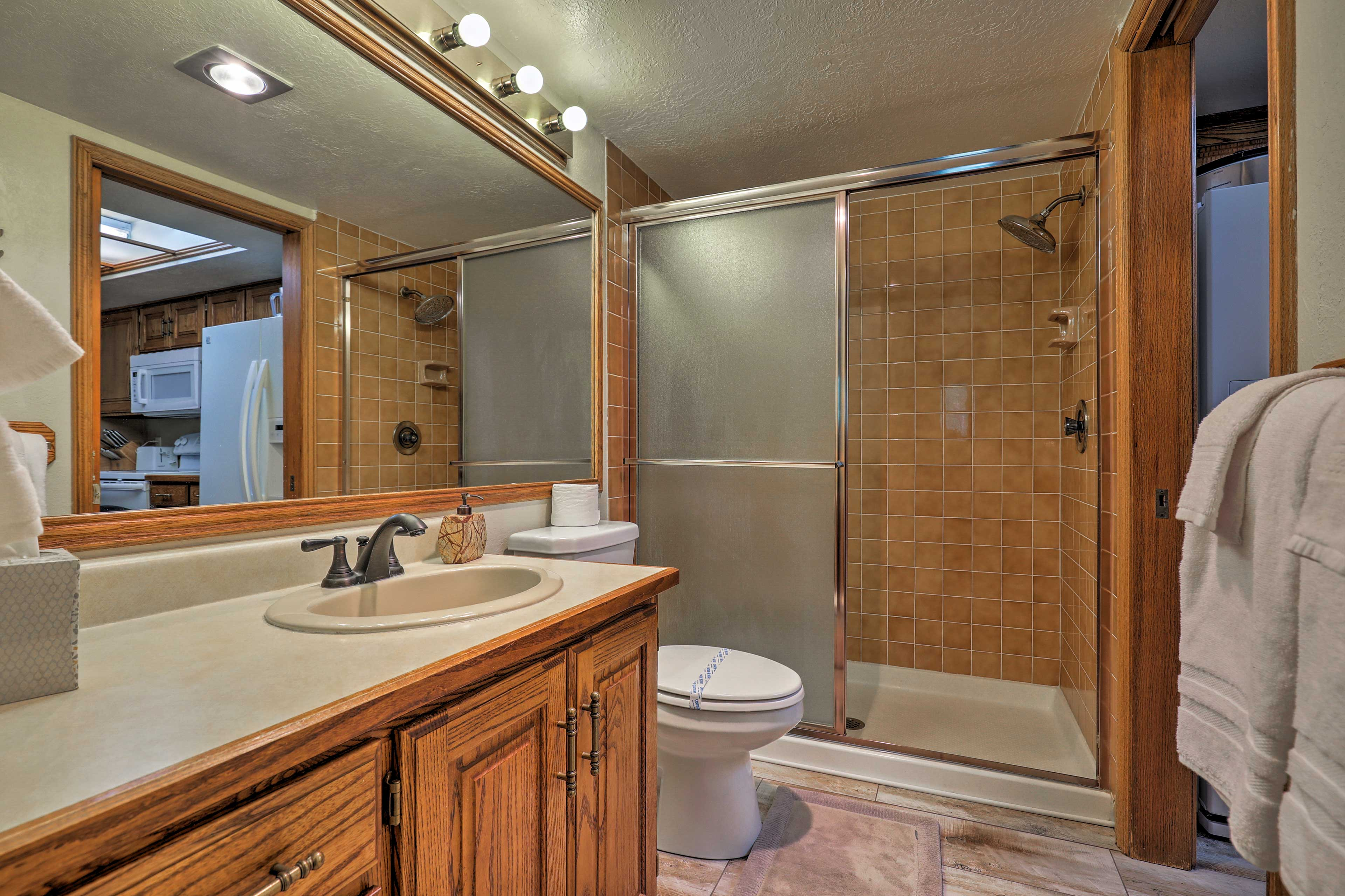 The second full bathroom offers a walk-in shower.