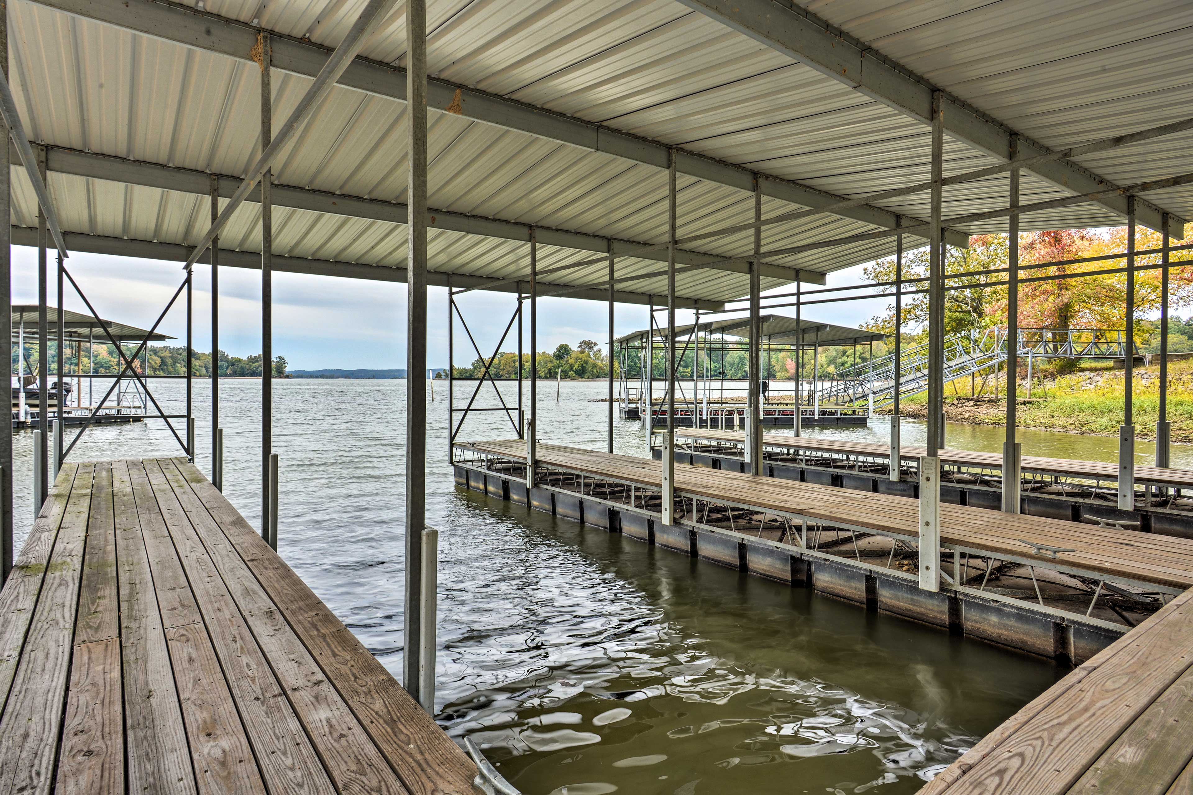 This property offers access to a dock, fire pit, and furnished deck.