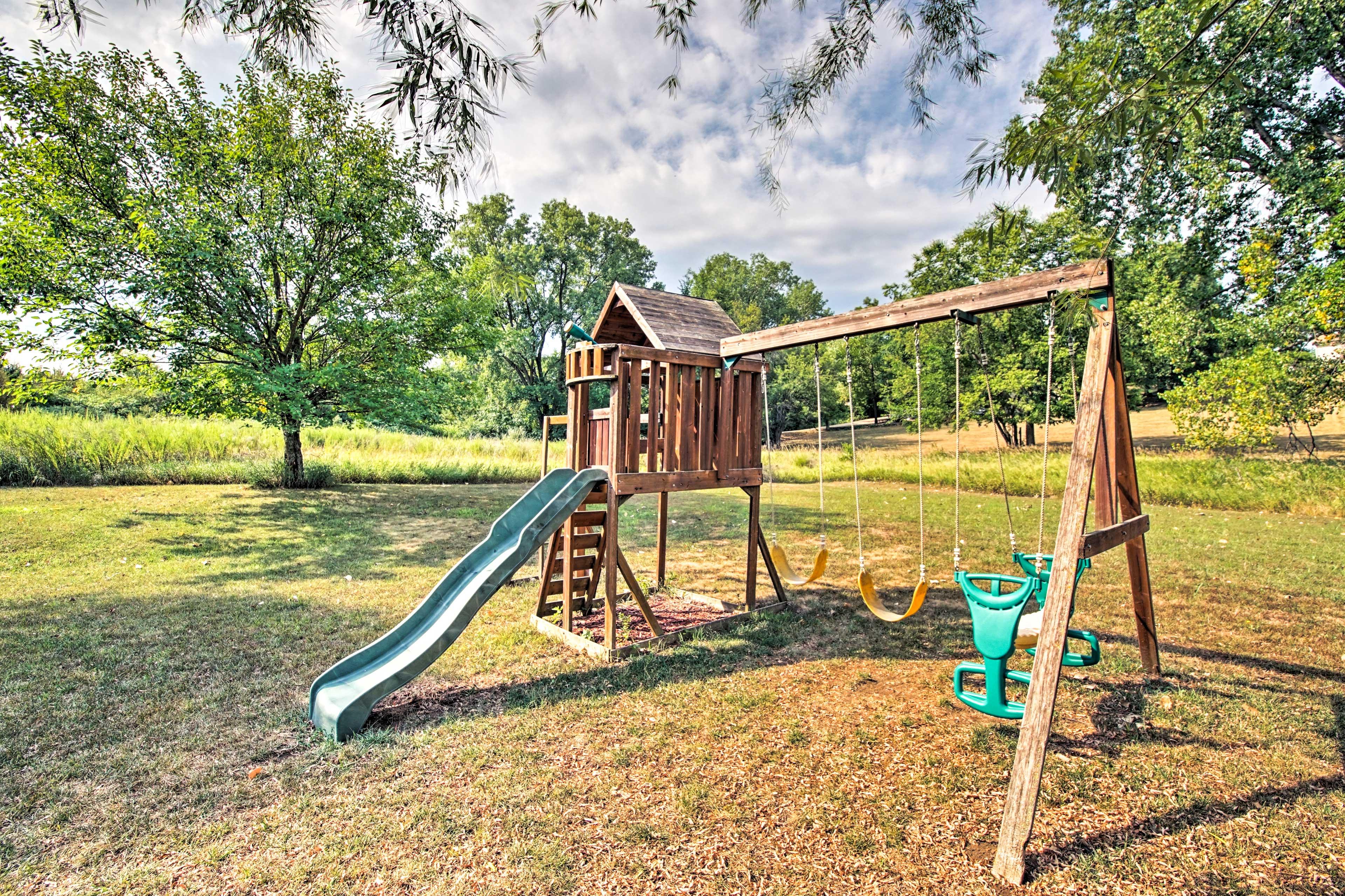 Let the kids romp around on the playground set.