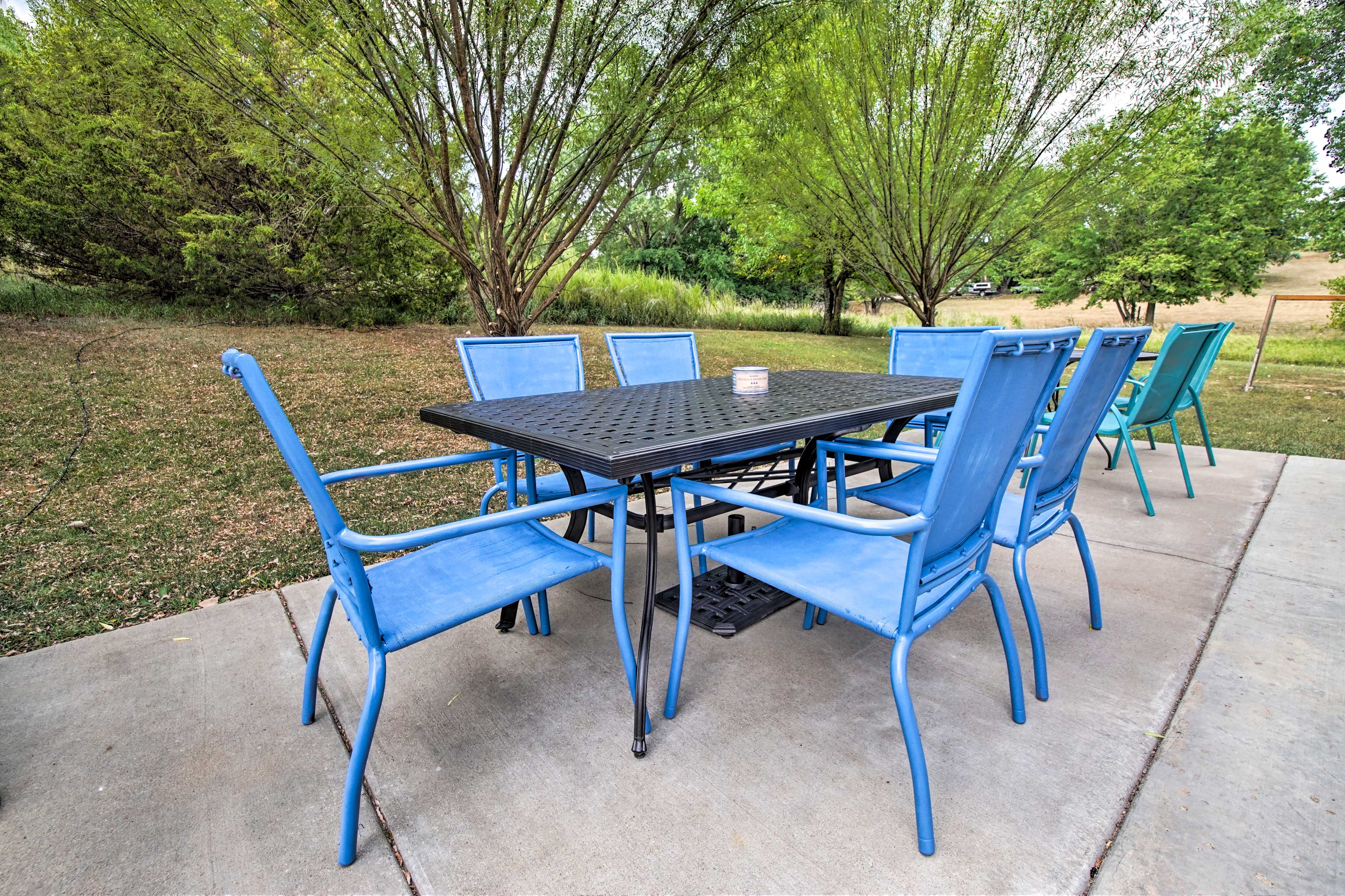 This home includes outdoor dining and a playground set!