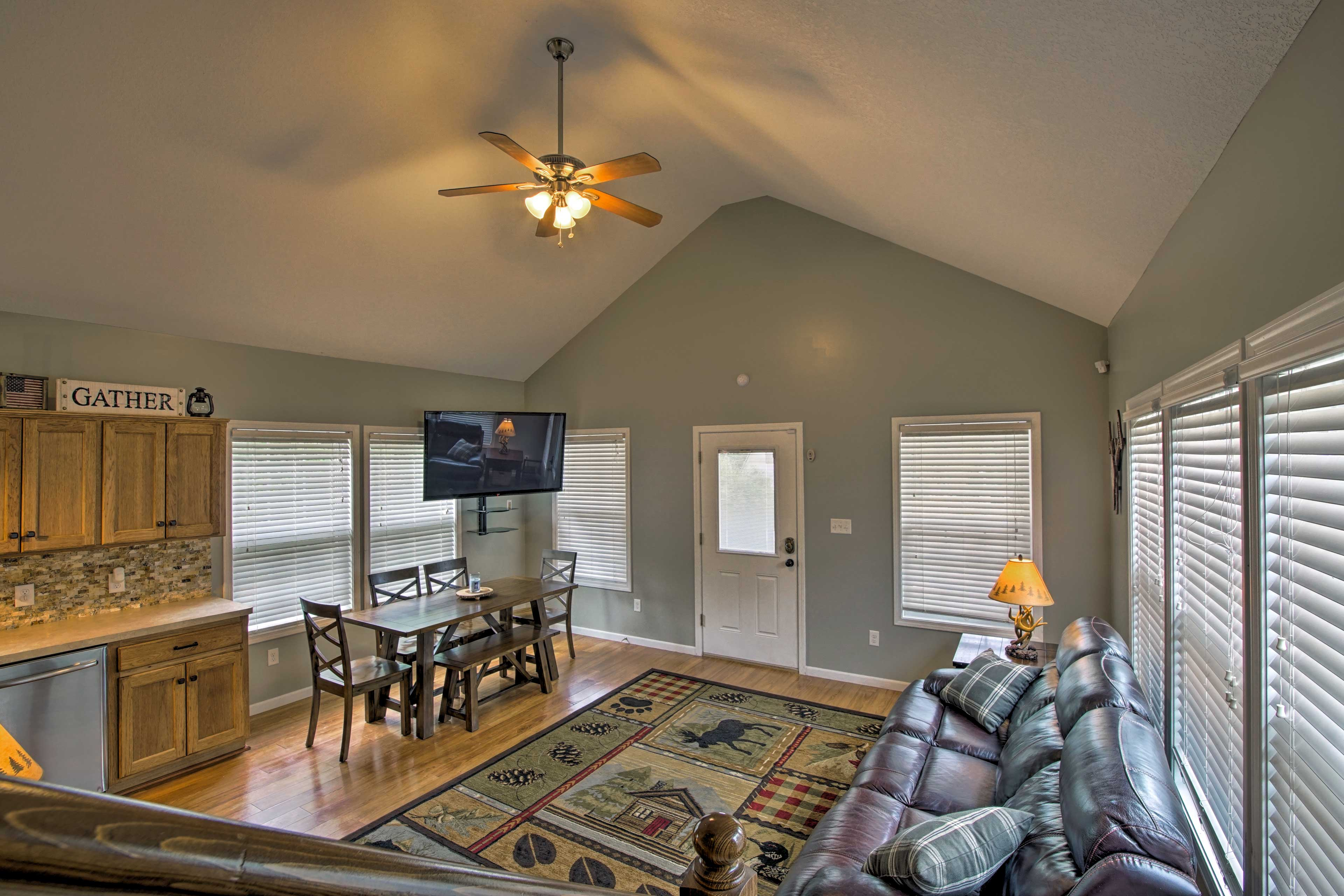 The spacious living rom features vaulted ceilings and hardwood floors.