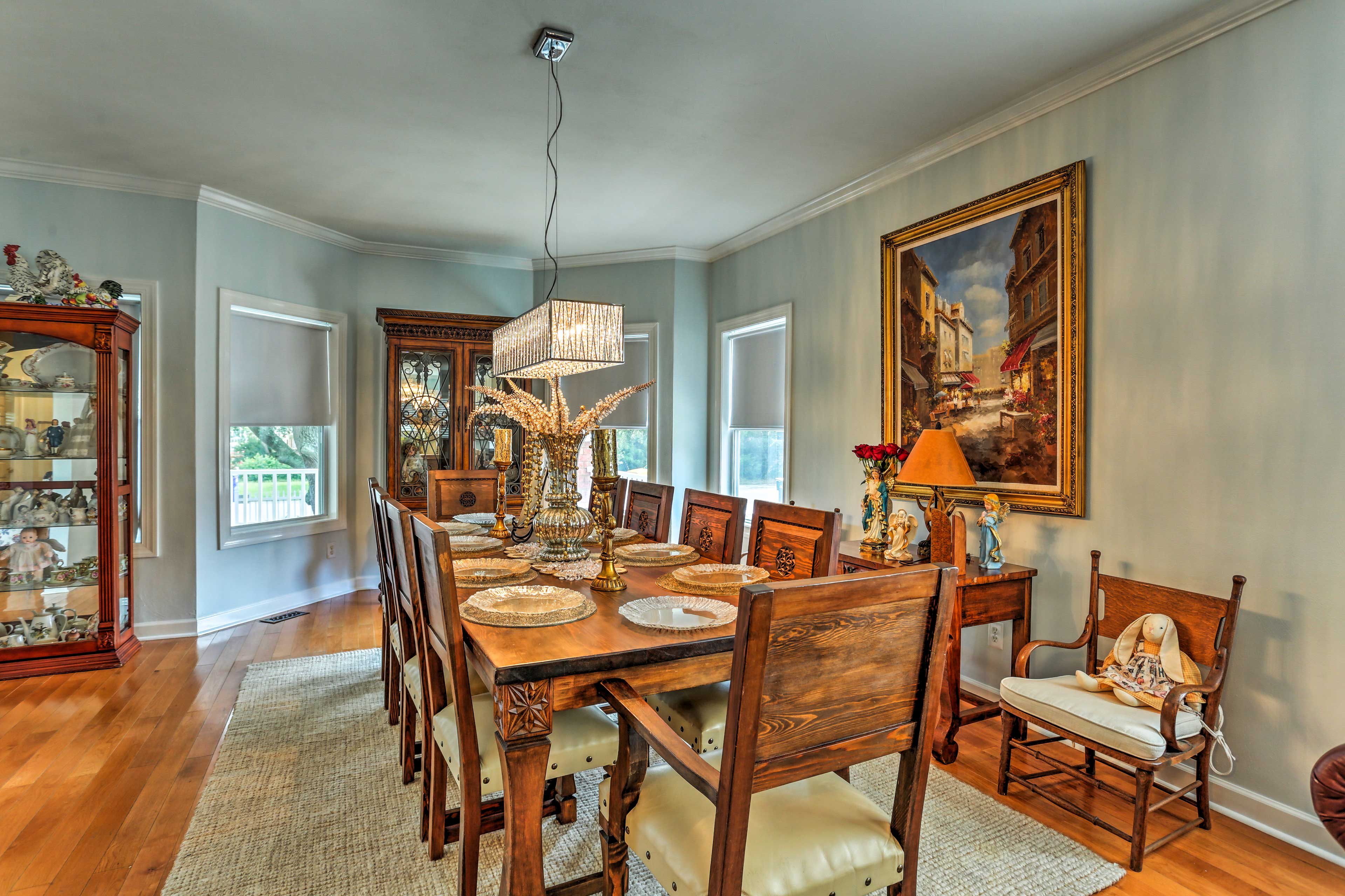 Savor feasts and family while dining around this elegant 10-person table.