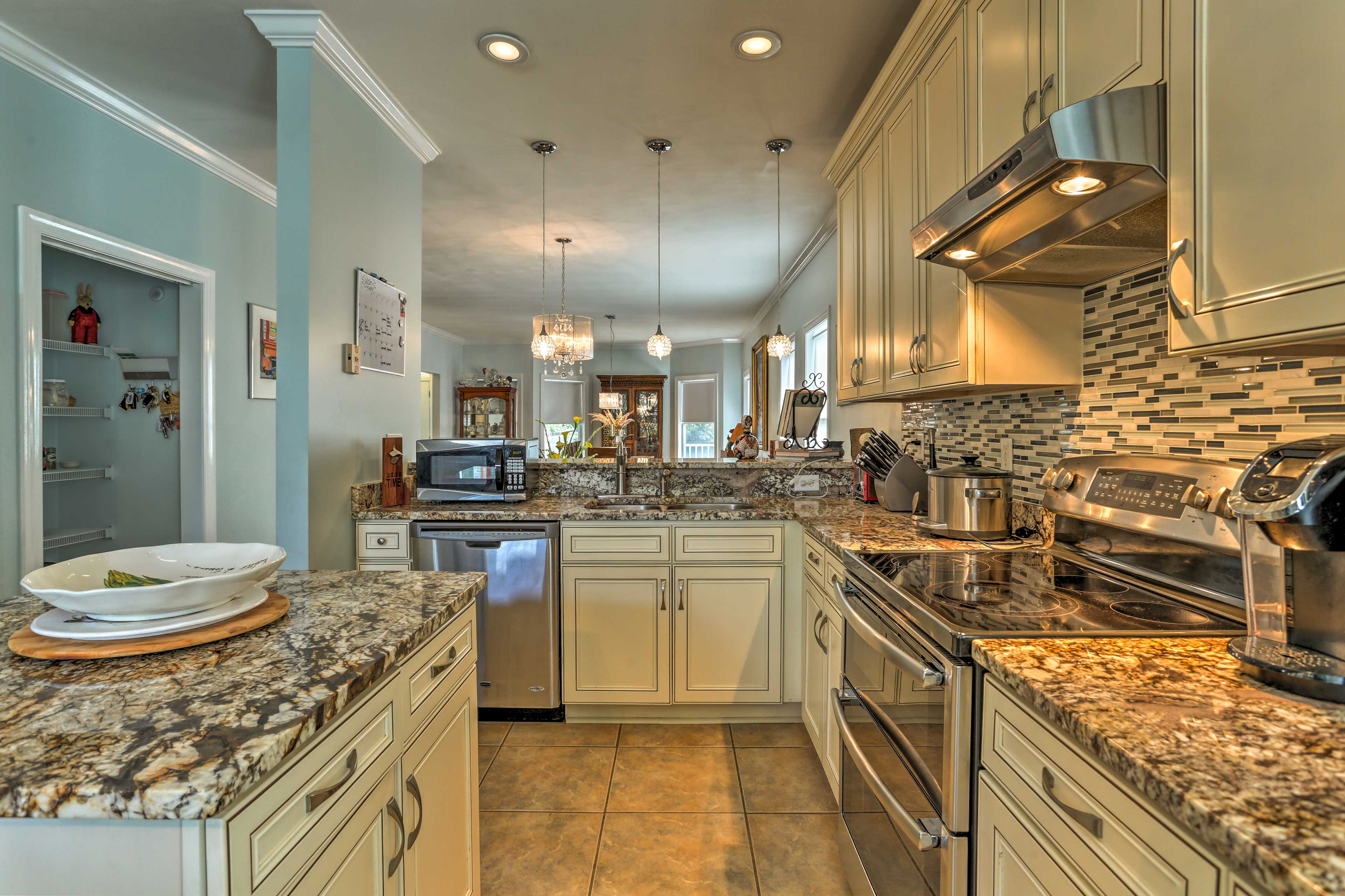It features granite countertops and stainless steel appliances.