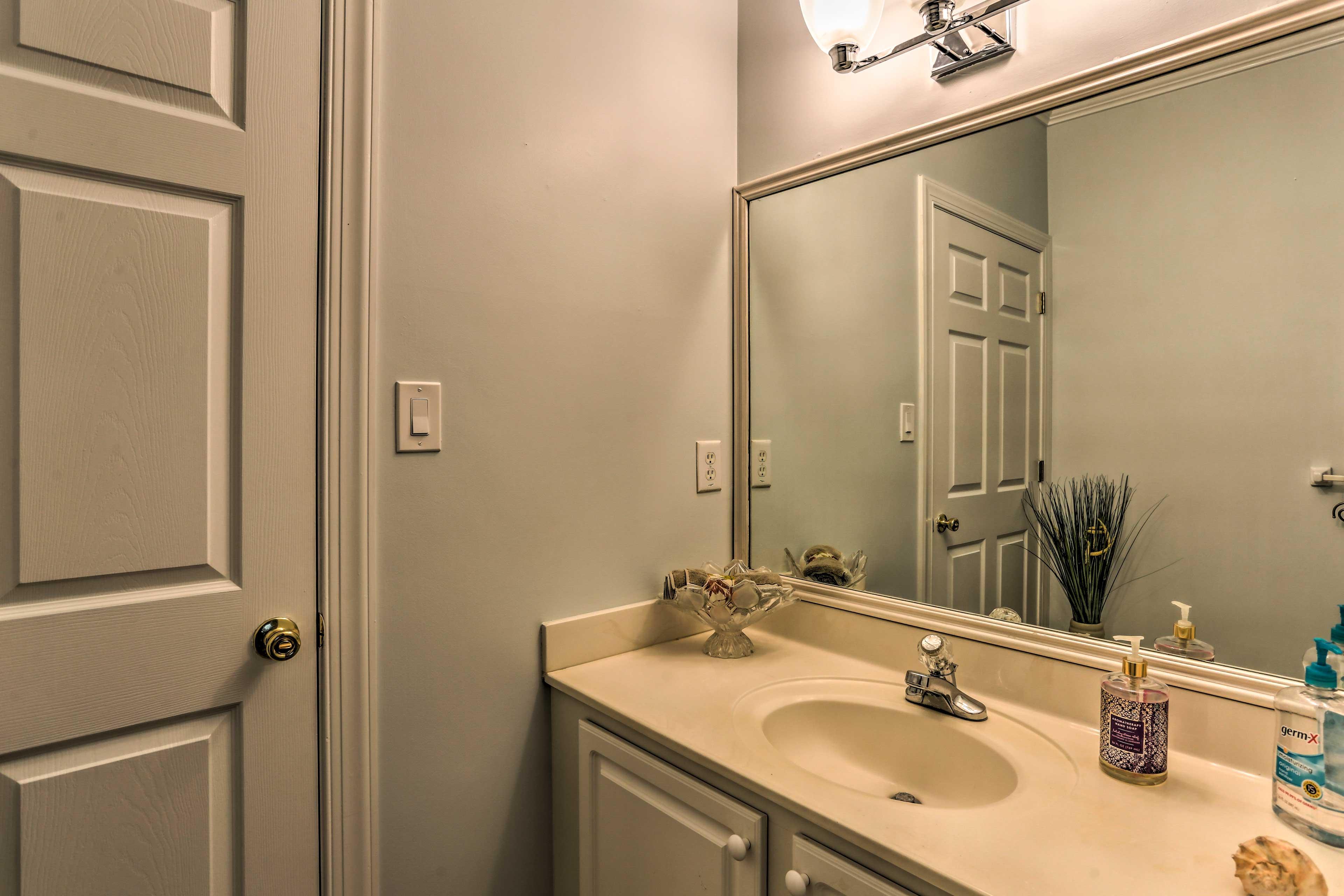 Wash up in the convenient half bathroom.