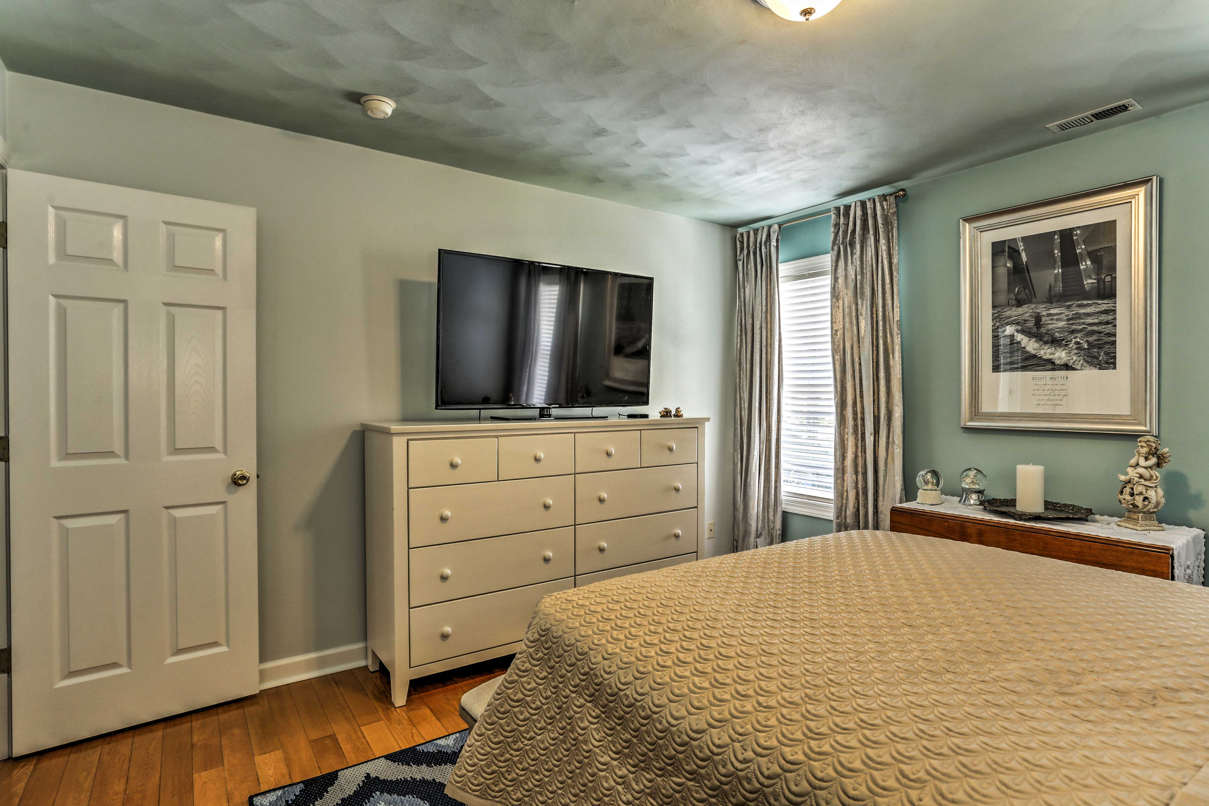 This bedroom also boasts a large flat-screen Smart TV.