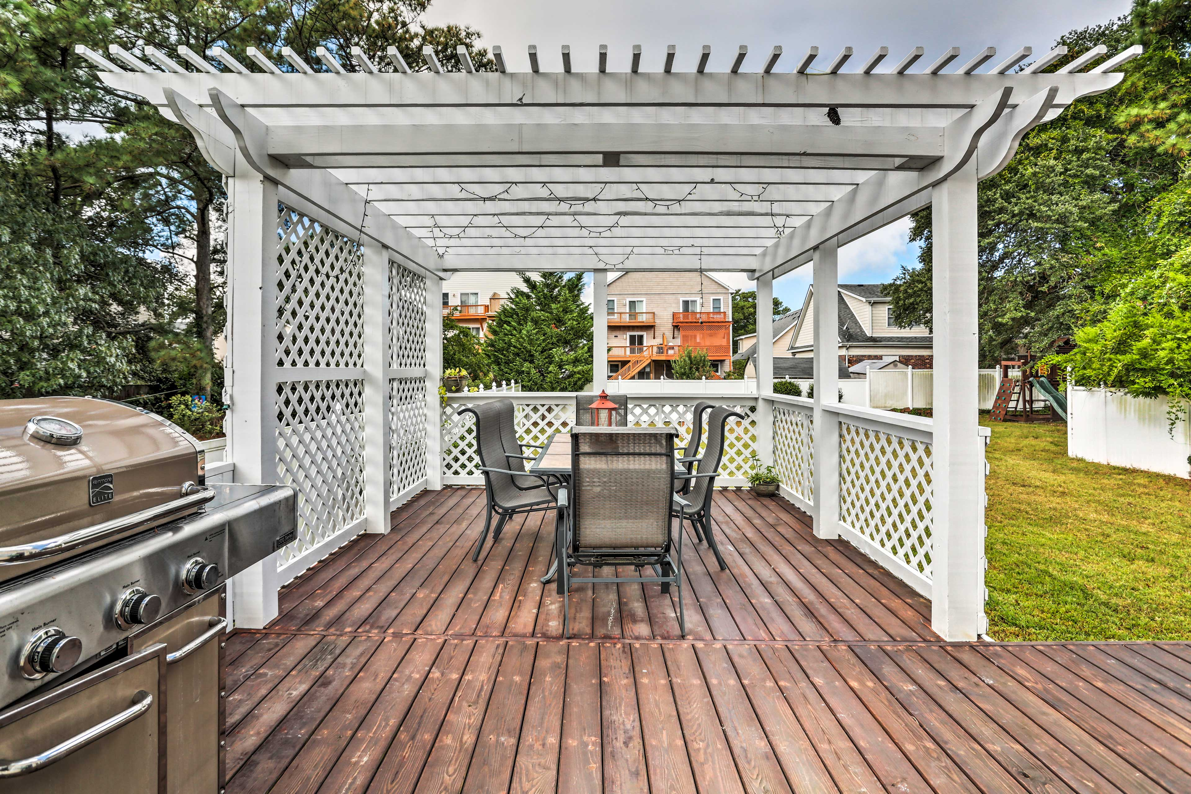 The home features incredible amenities, including a furnished porch & gas grill!