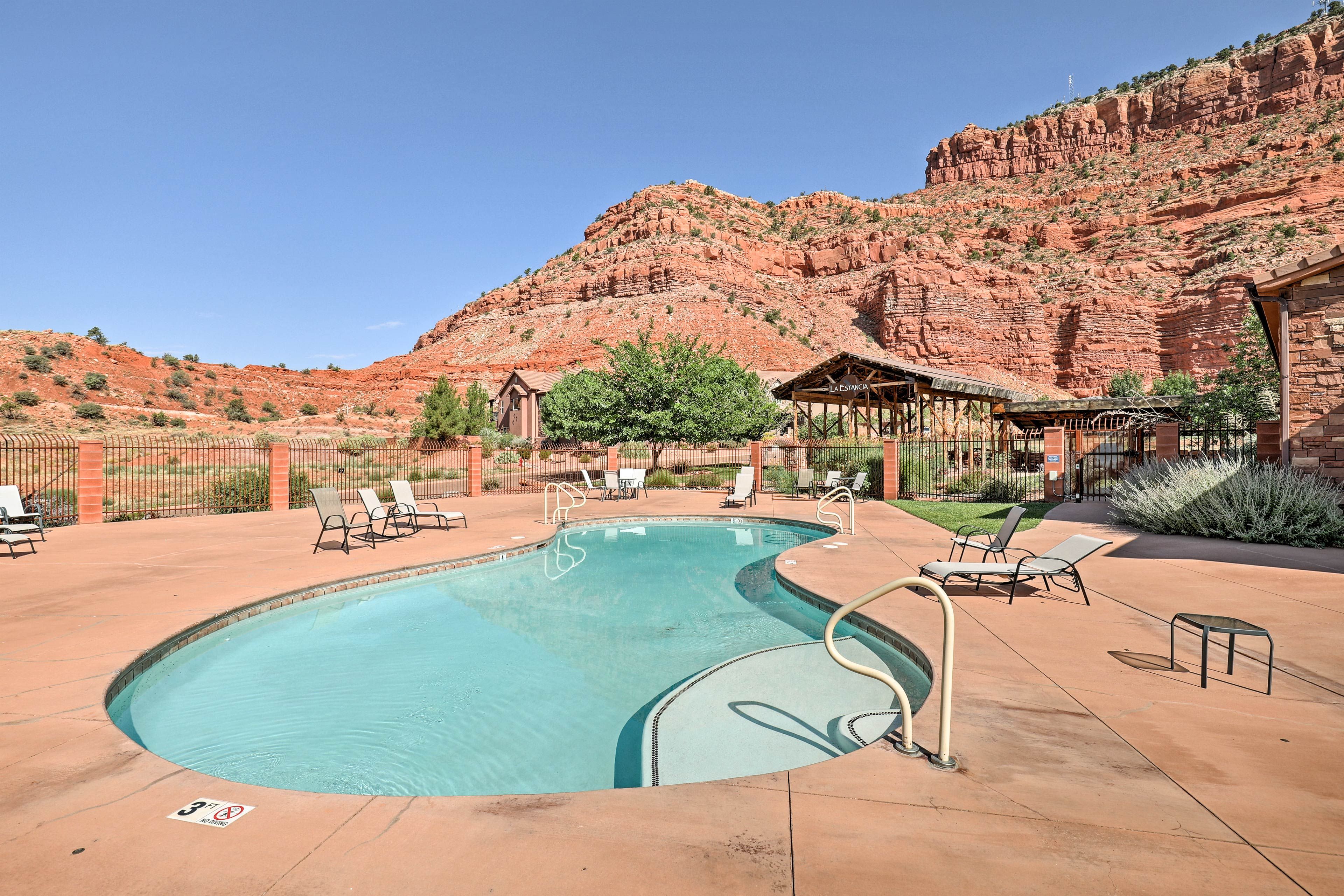 This home offers an array of luxury amenities including a community pool!