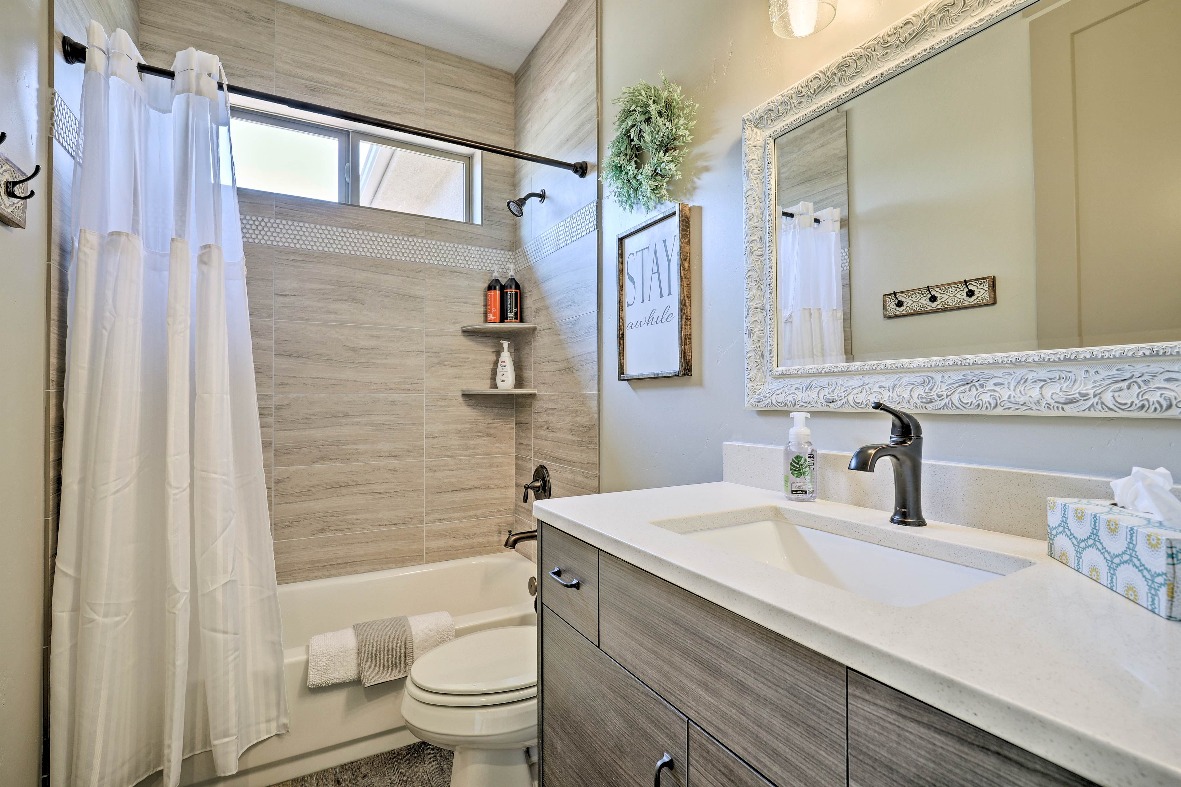 The second bathroom features a shower/tub combo.