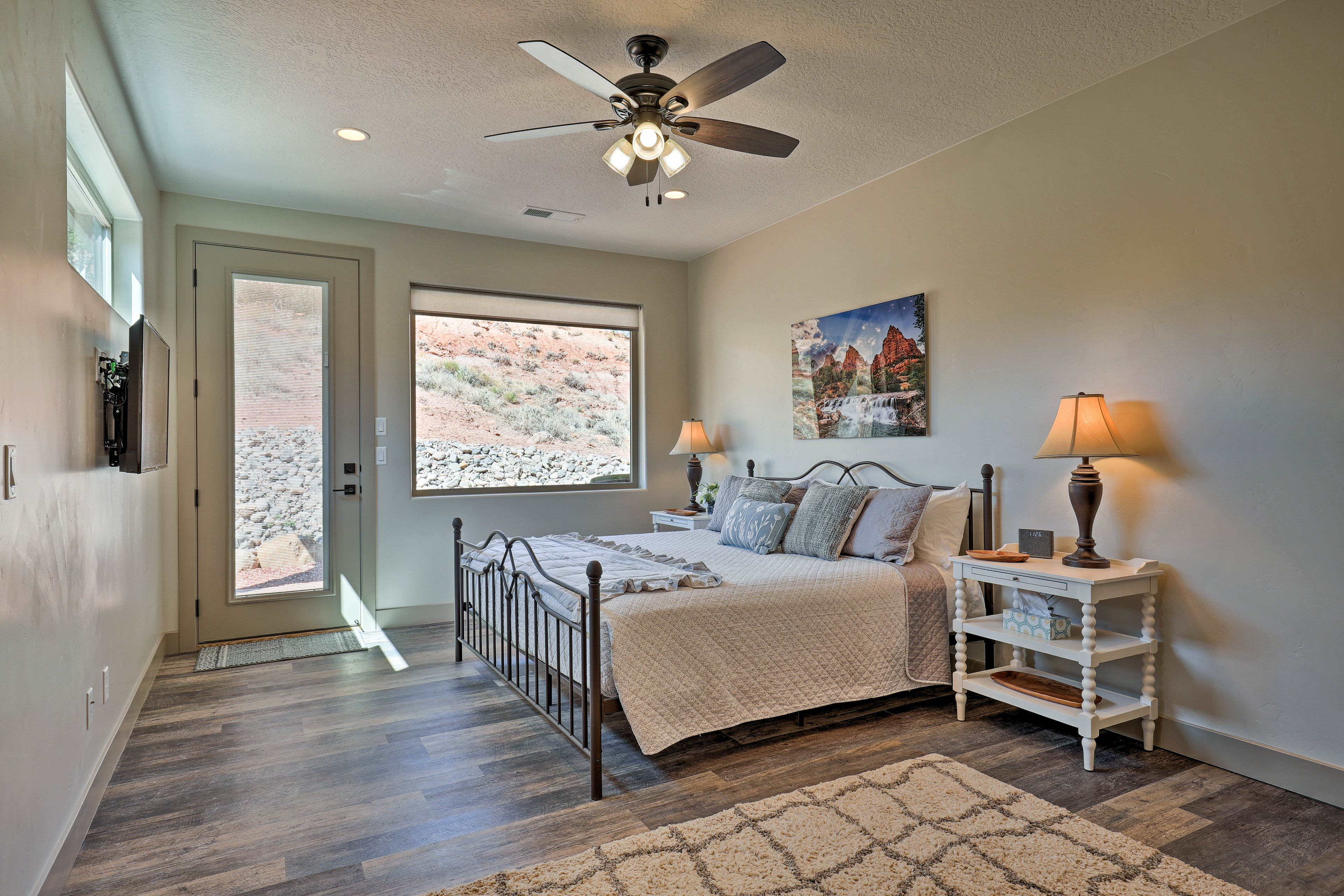 The master bedroom boasts a lustrous king bed.