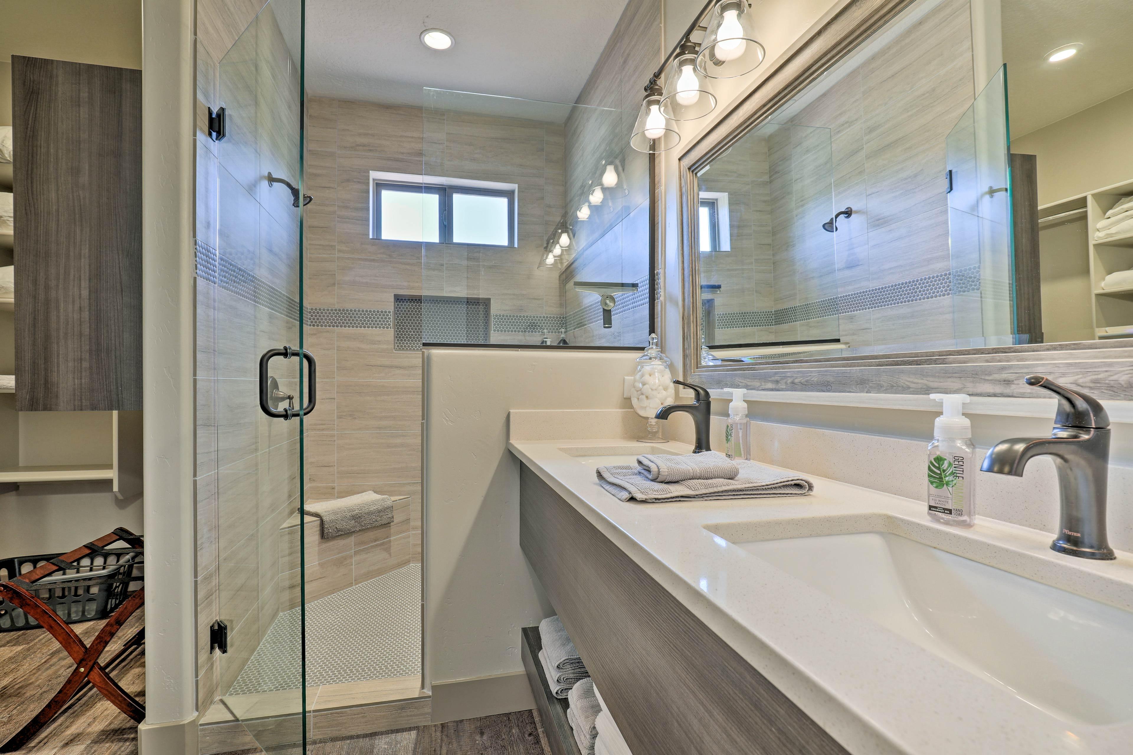 The master bedroom offers an elegant en-suite bathroom with a walk-in shower.