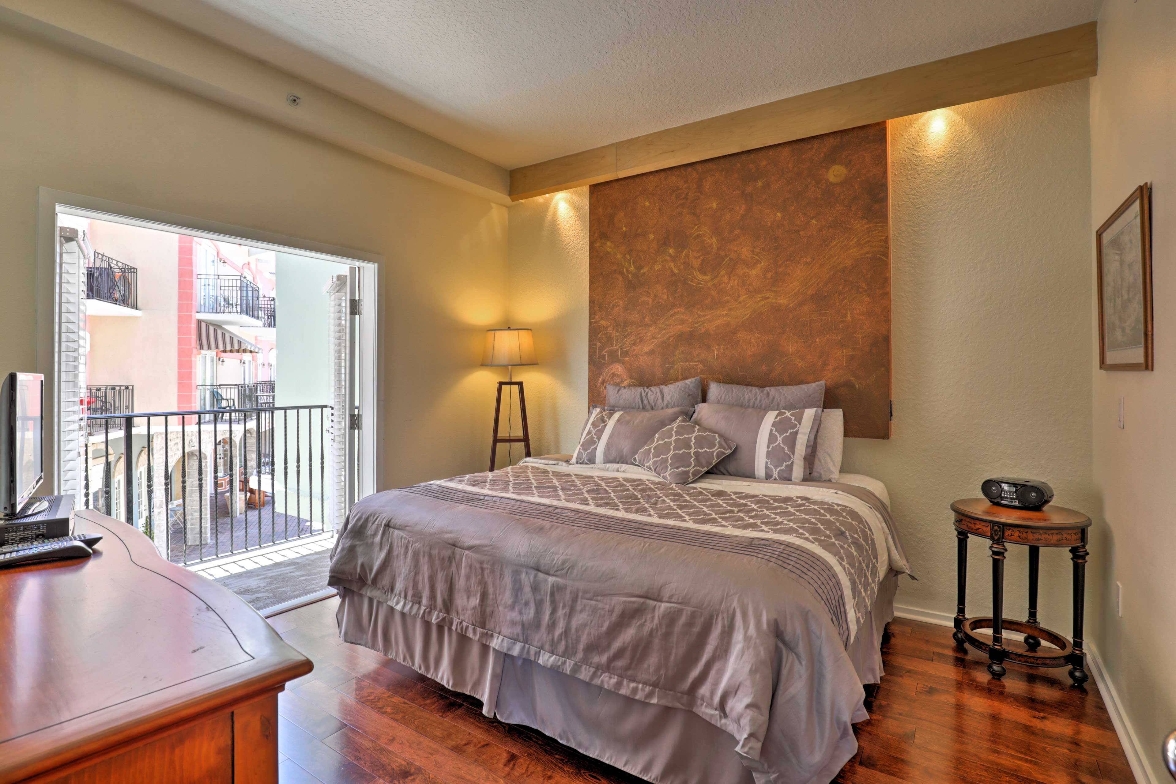 The bedroom boasts a king bed.