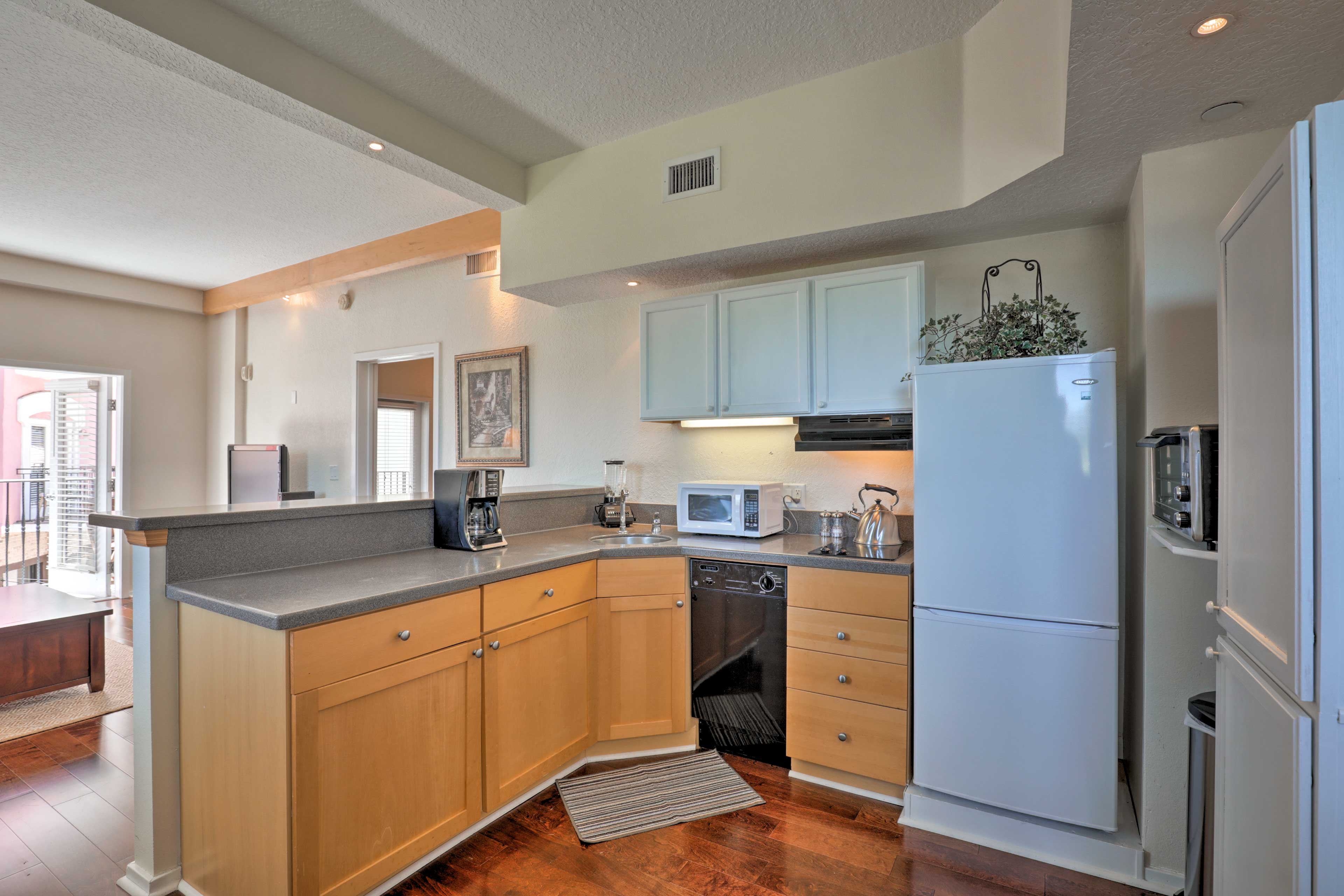 With a 2-burner stove, this condo makes cooking a breeze.