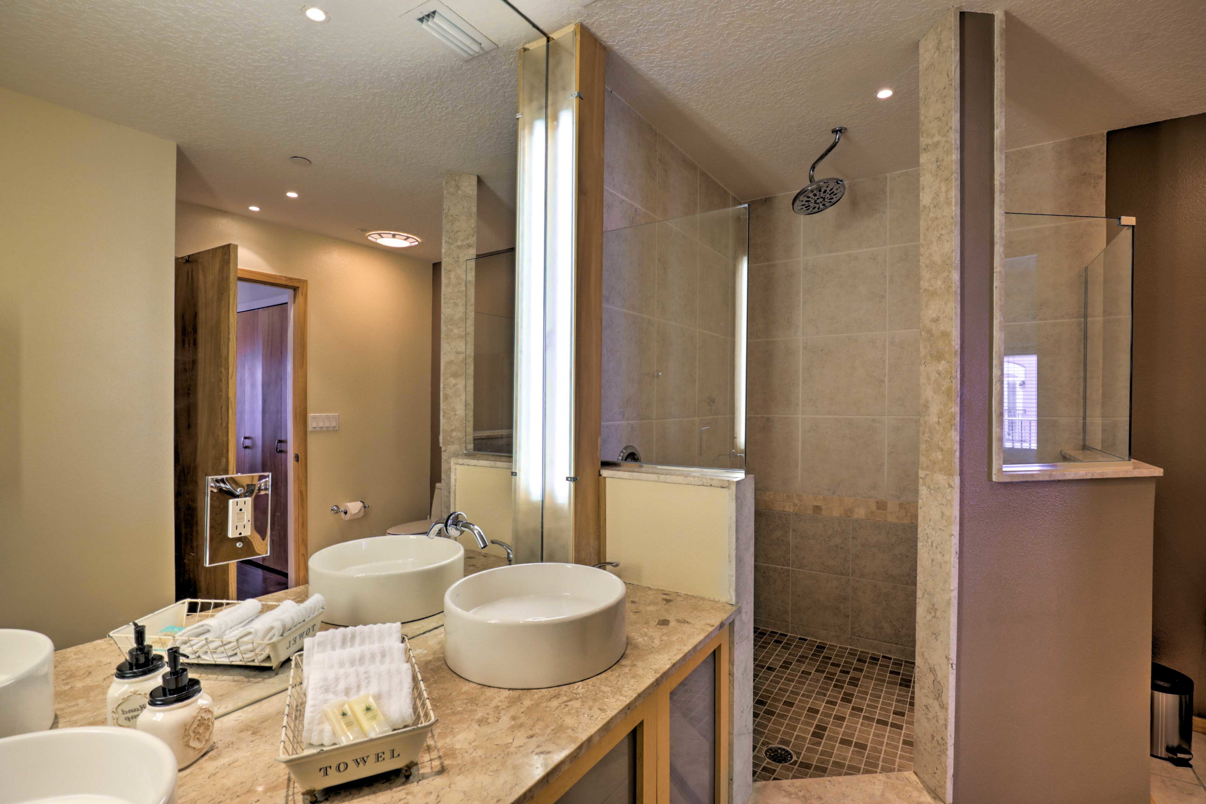 Take a cleansing rinse in the walk-in shower.