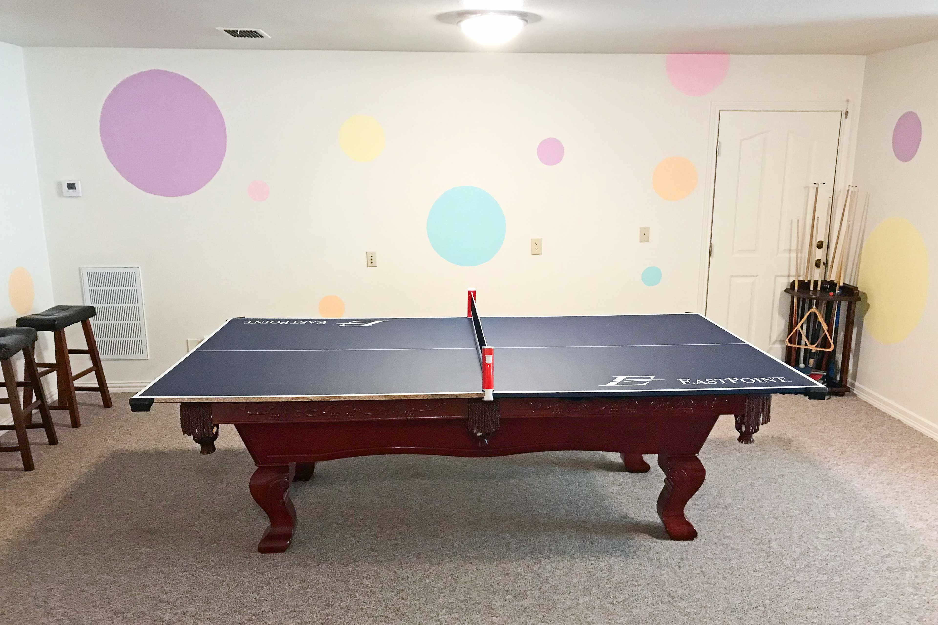 The billiards table transforms into a ping-pong table.