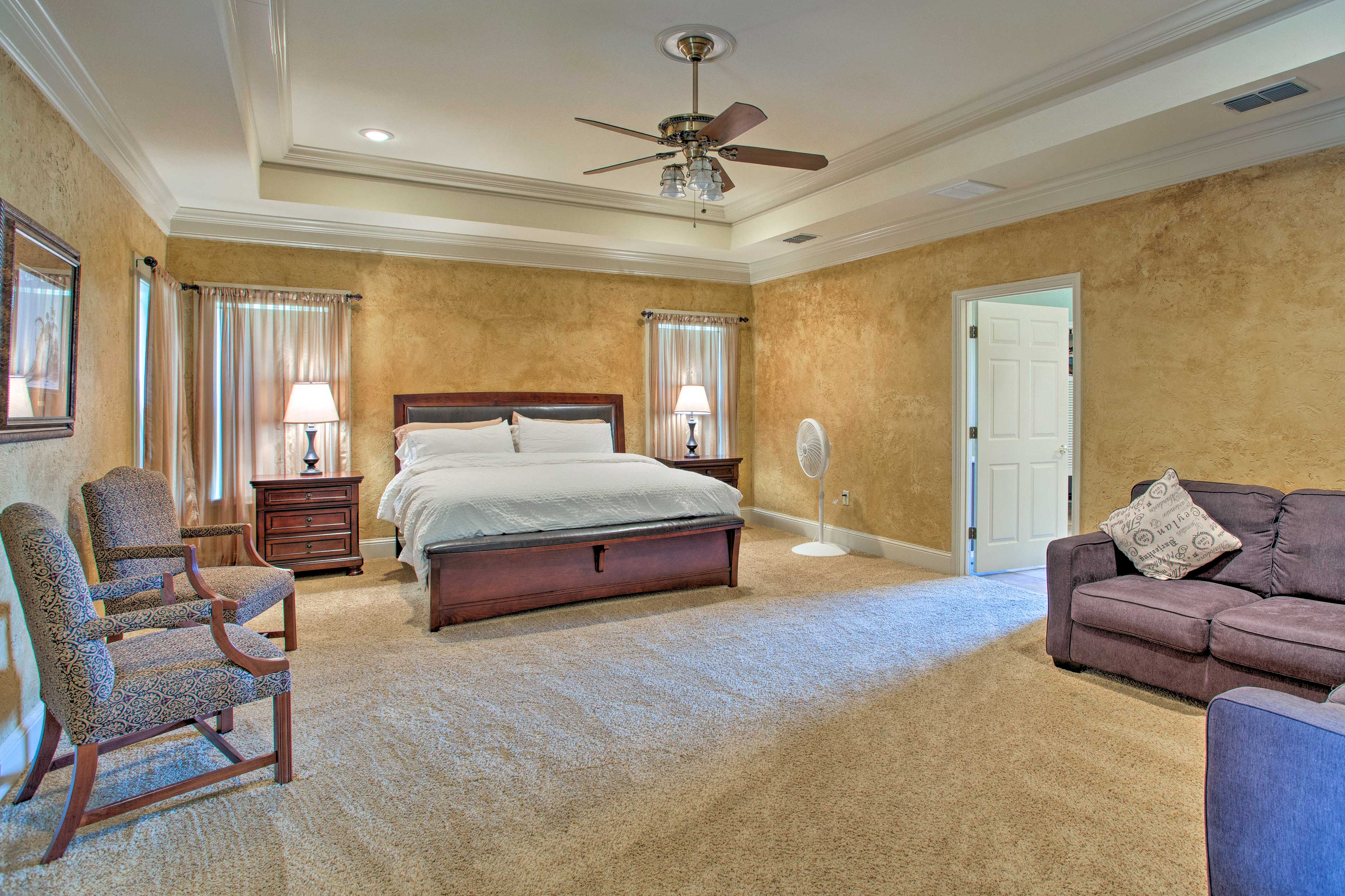 The spacious king master suite features a tiered ceiling.