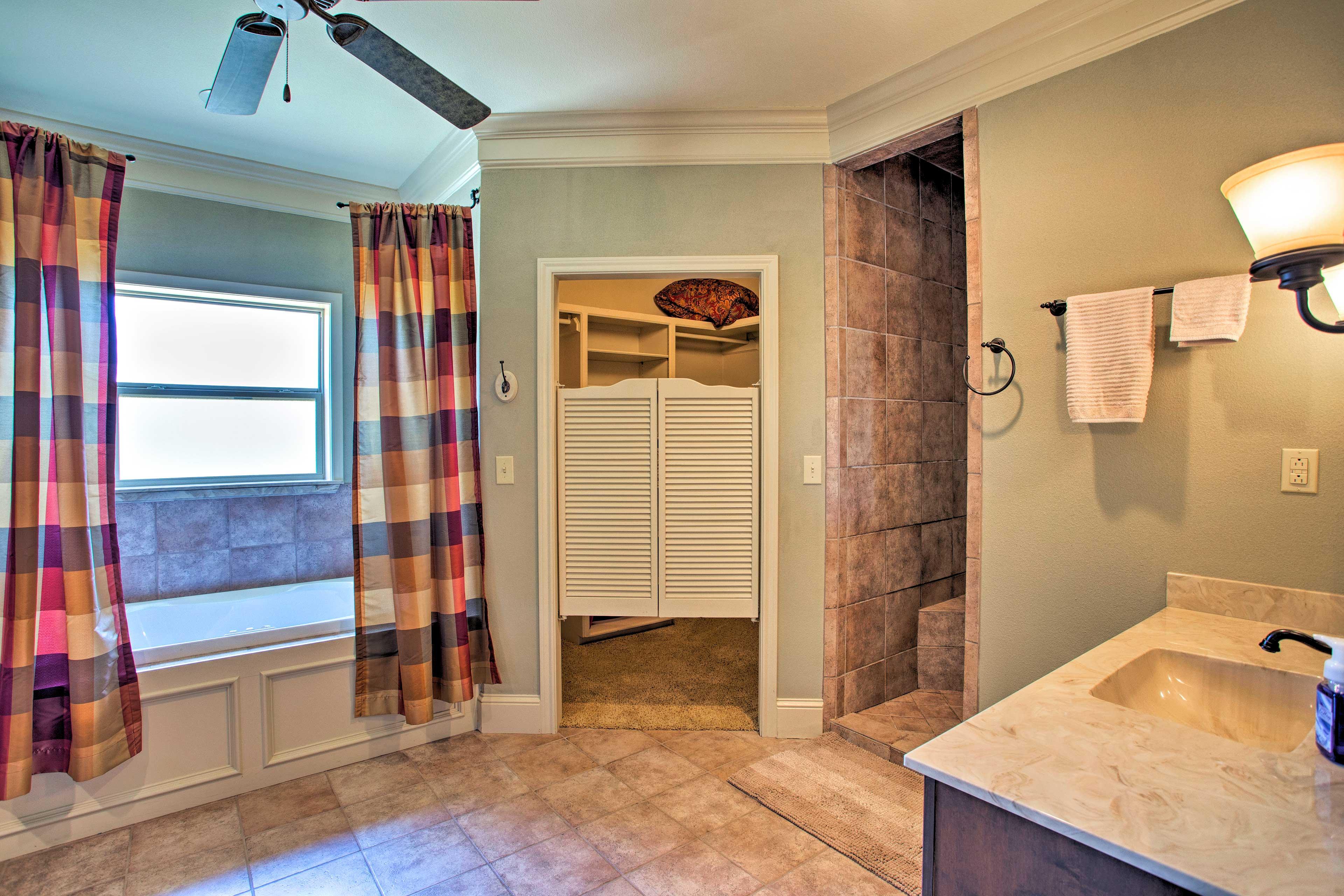 The en-suite bathroom also has a walk-in closet.