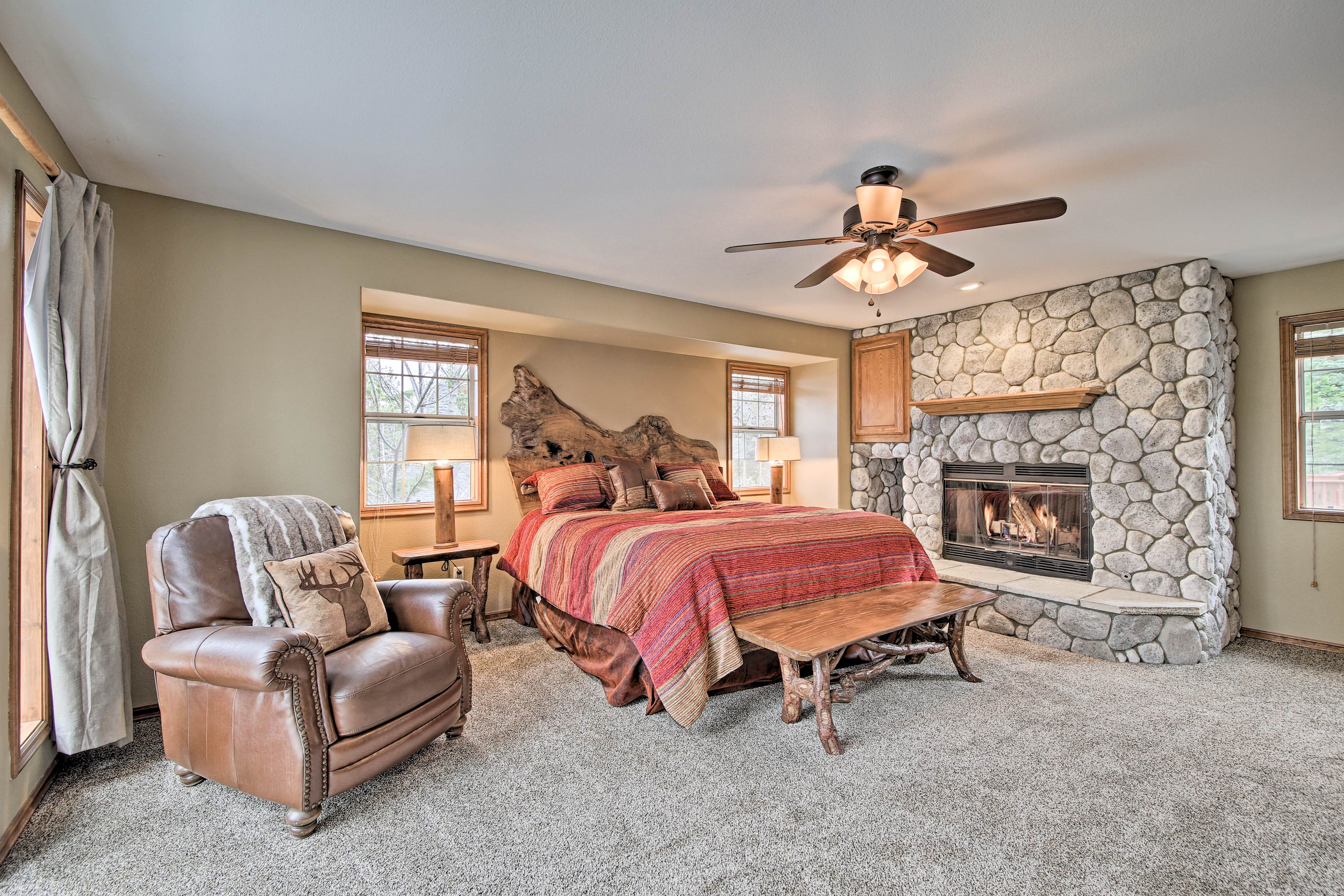 Sneak away for fireside reading in the comfort of the king bed.