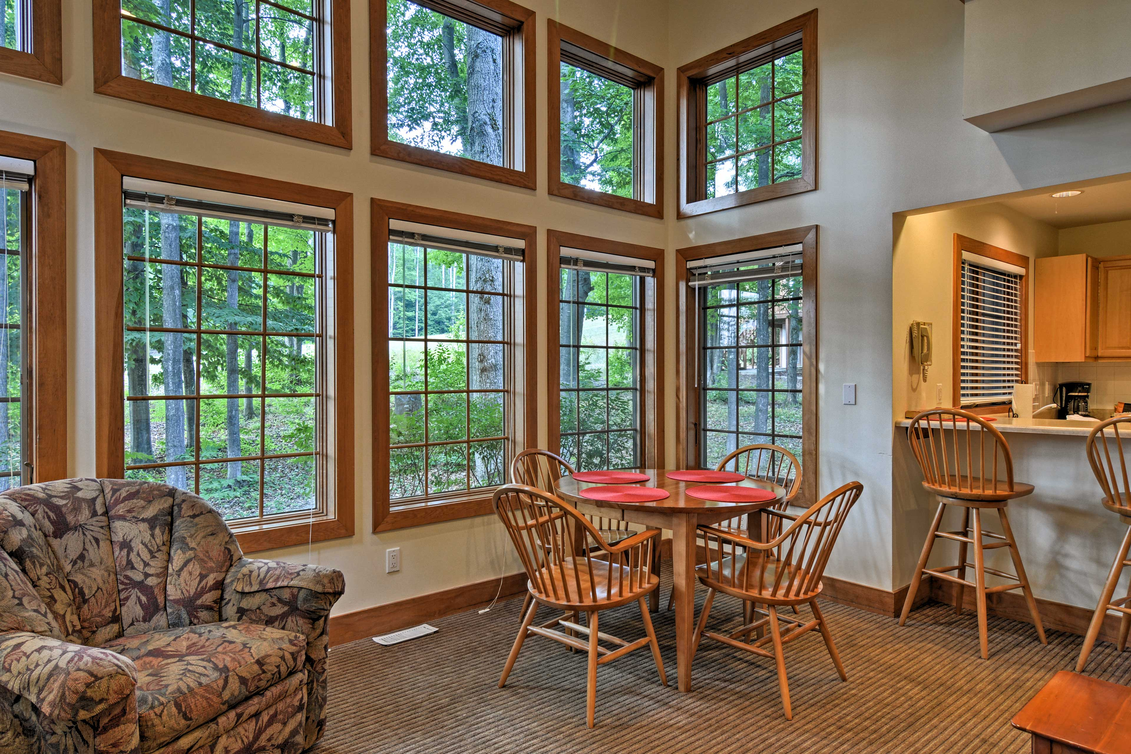 You'll love the natural light & pretty view from these floor-to-ceiling windows!