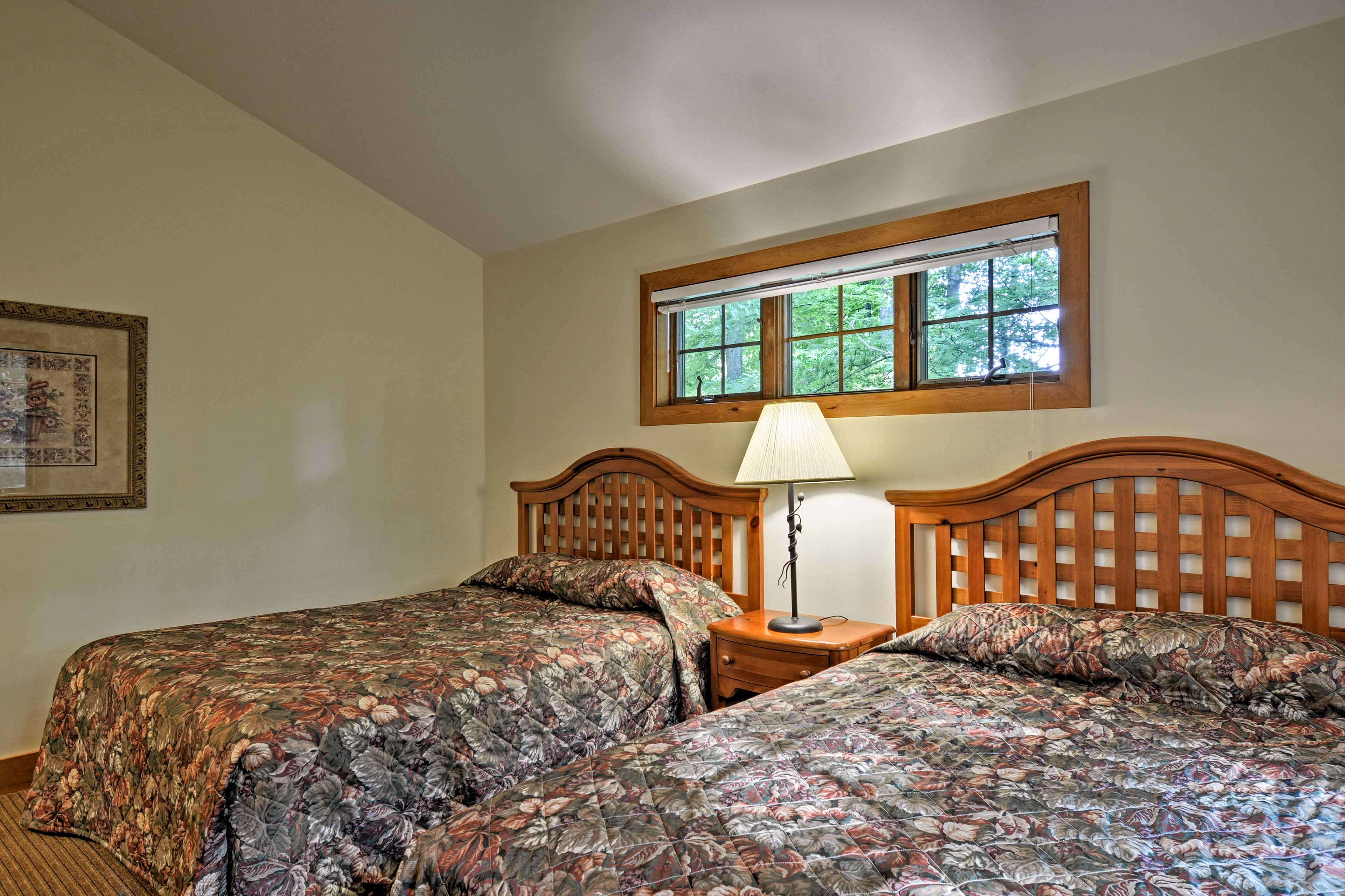 Multiple vacationers can peacefully sleep in these 2 queen-sized beds.