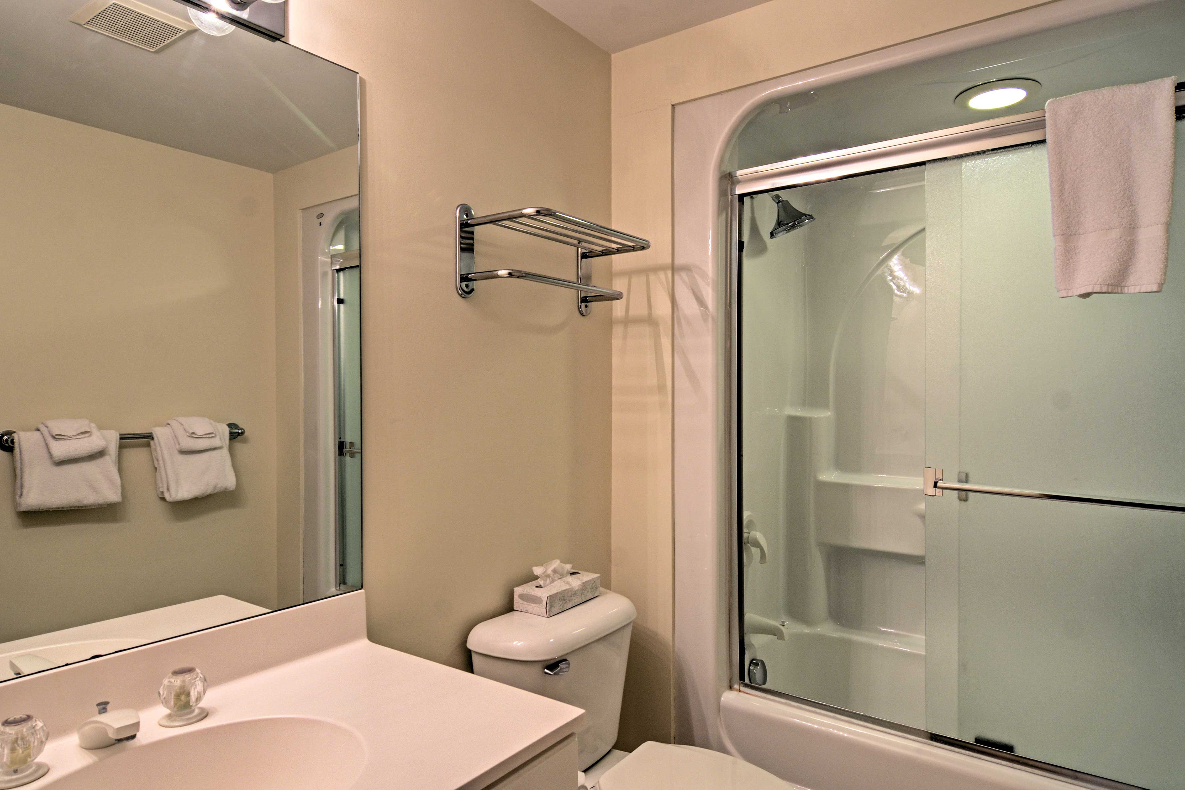 Take a refreshing shower in this lovely shower/tub combo.