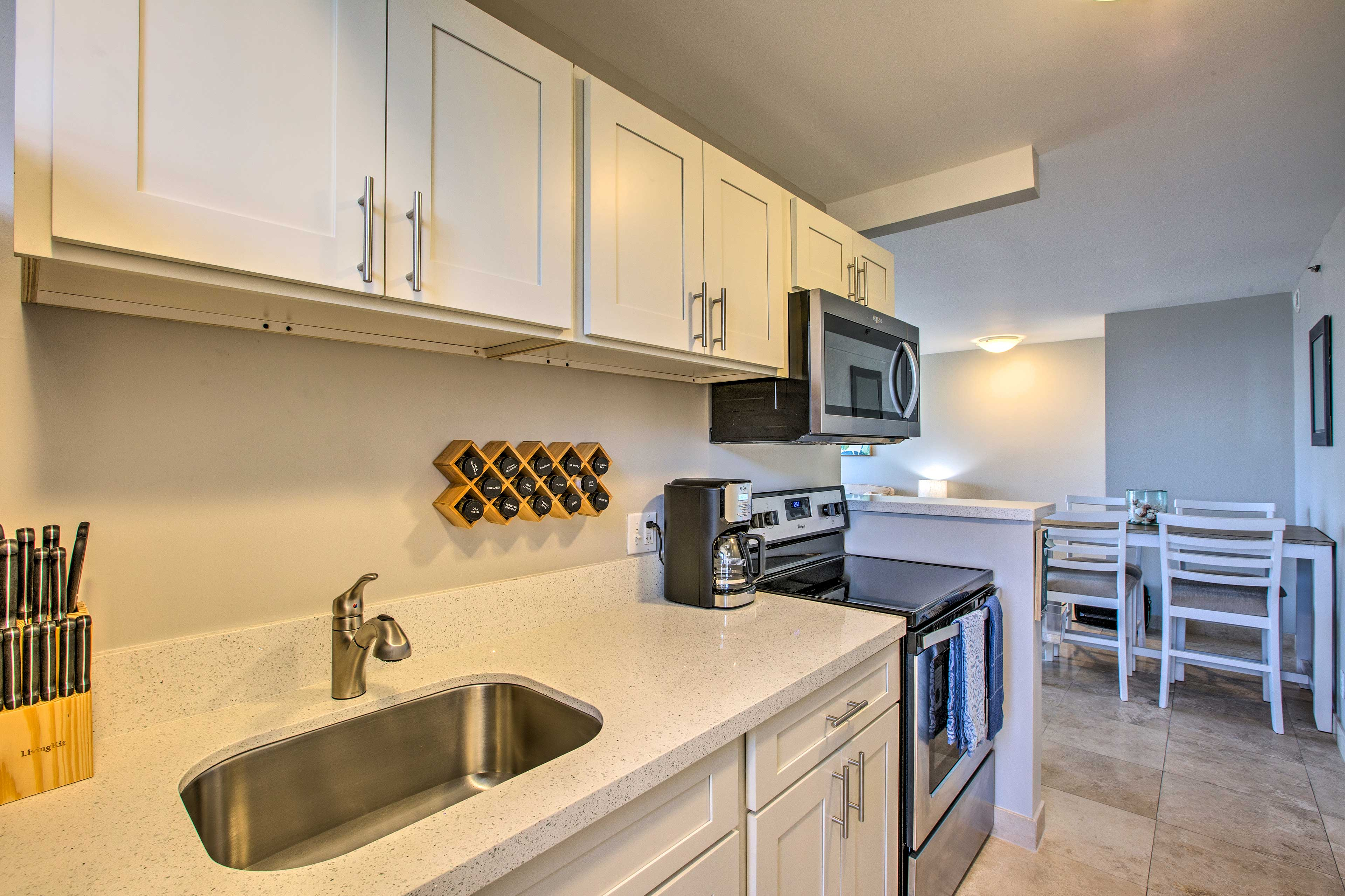 The kitchen includes stainless steel appliances.