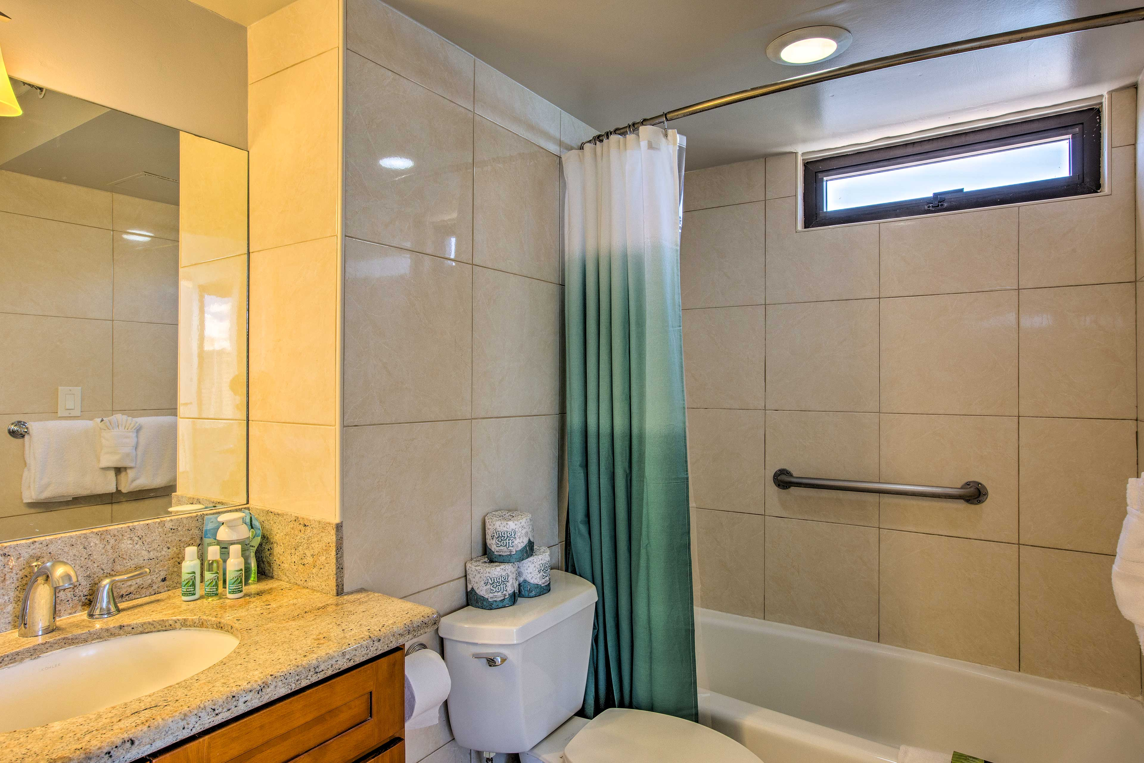 A tub/shower combo completes the full bathroom.