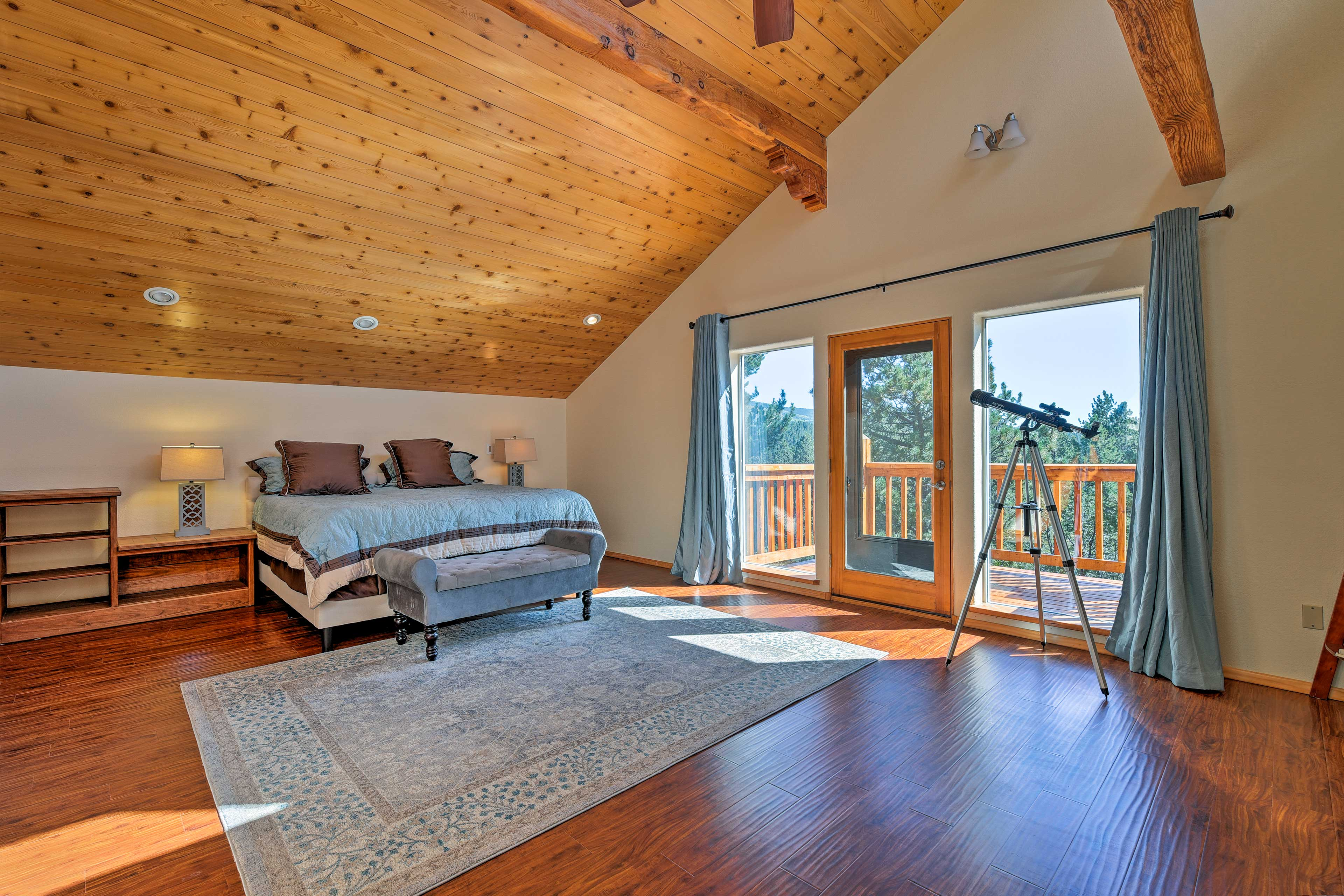 Upstairs, the master suite features hardwood floors and soaring ceilings.