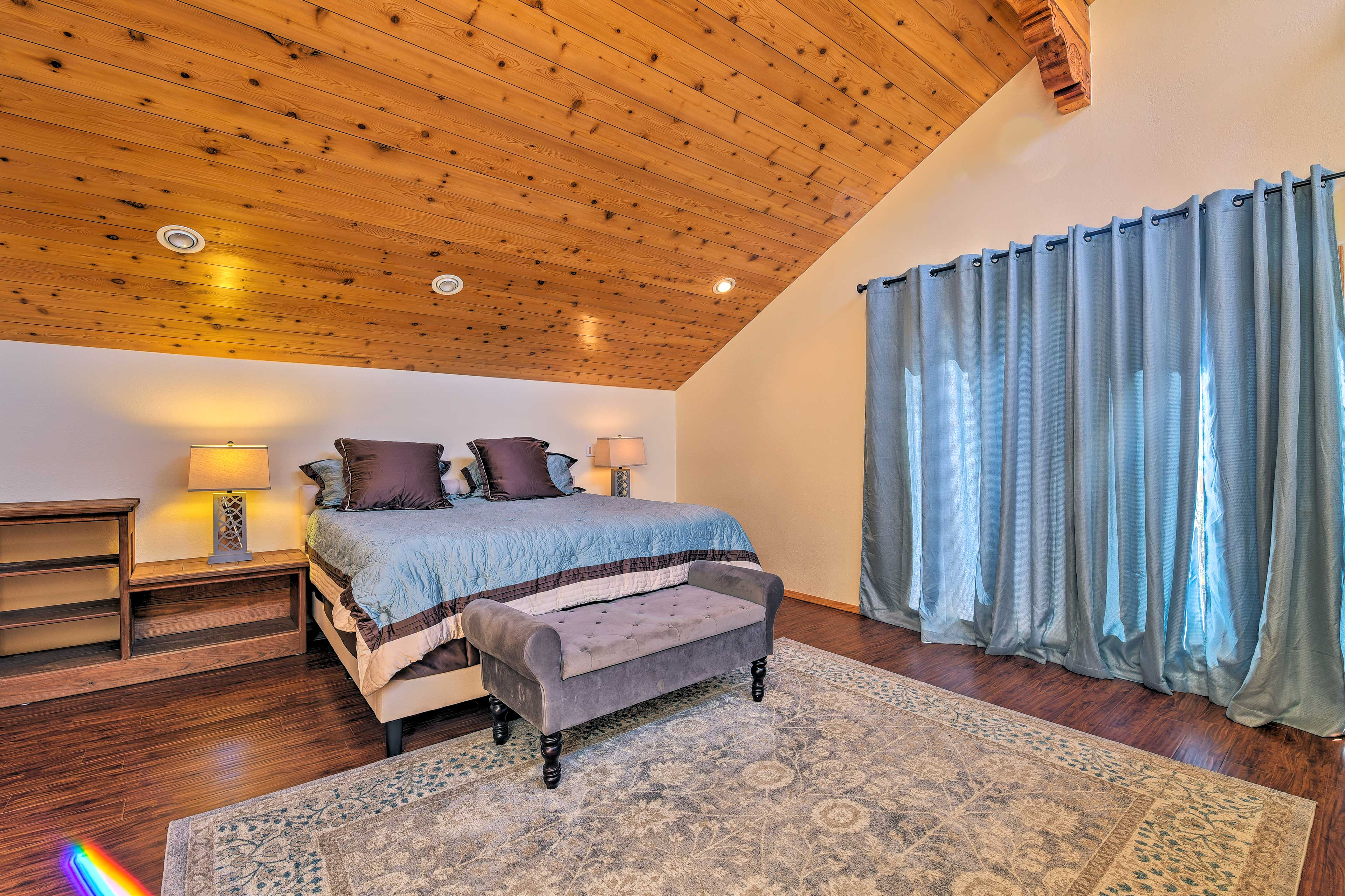 Close the curtains to catch a few more minutes of sleep in your plush king bed.