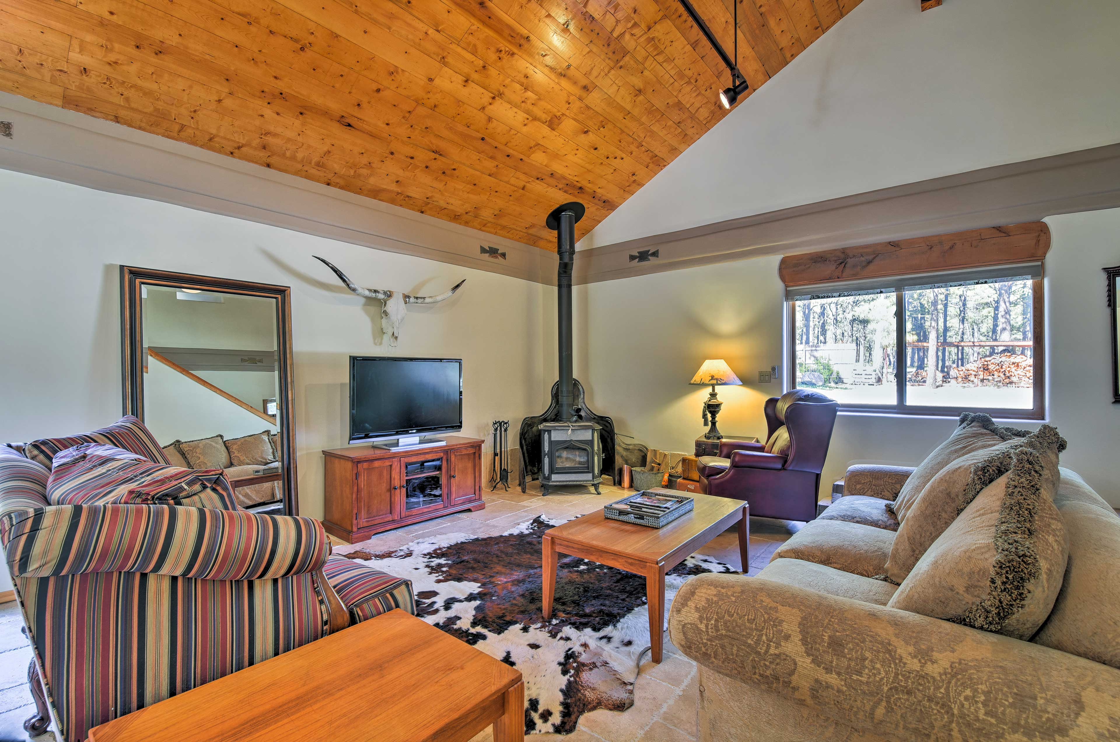 Unwind on the comfortable seating and stay cozy by the wood-burning fireplace.