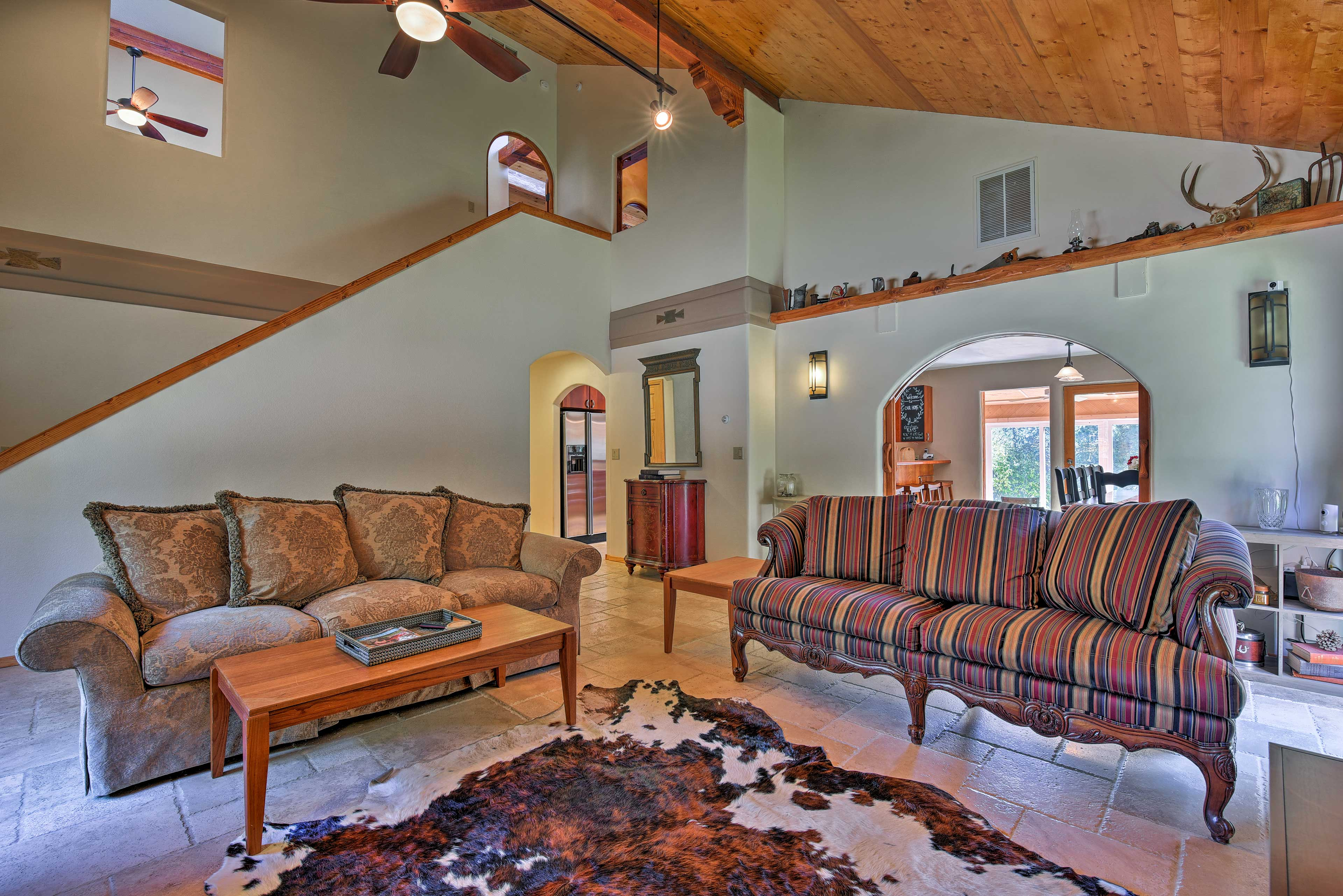 Vaulted ceilings and natural light invite you to relax.