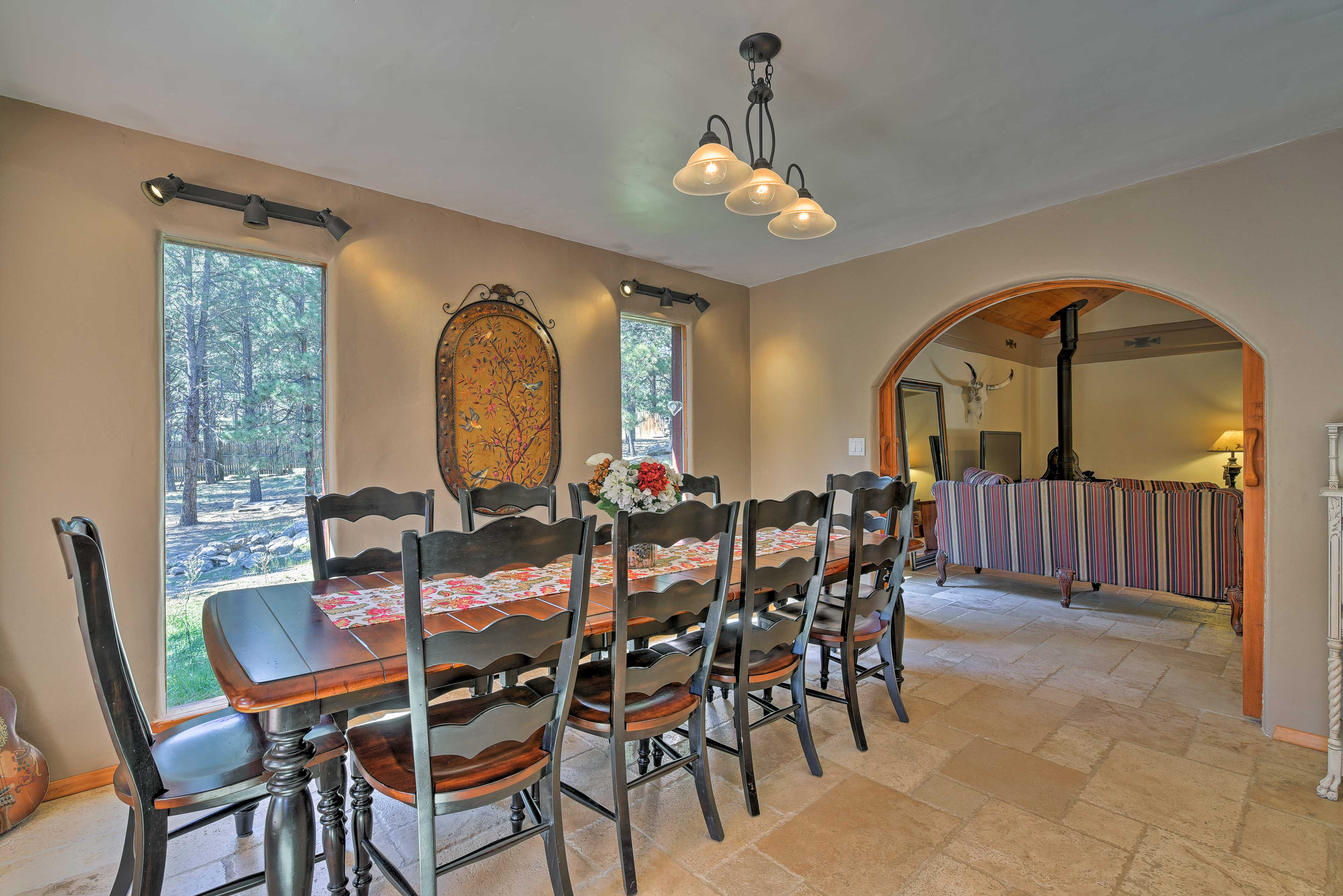 Step through the open archway to the 10-person dining table.