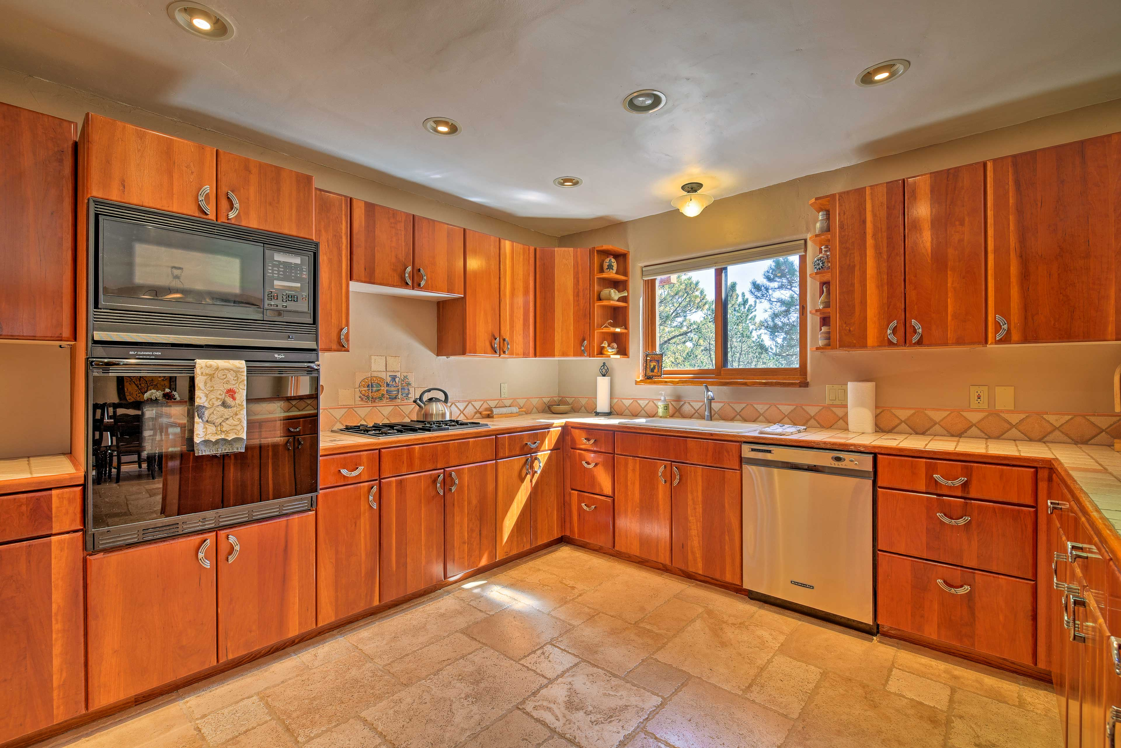 Gleaming cabinets hold everything you need to prepare your favorite dishes.