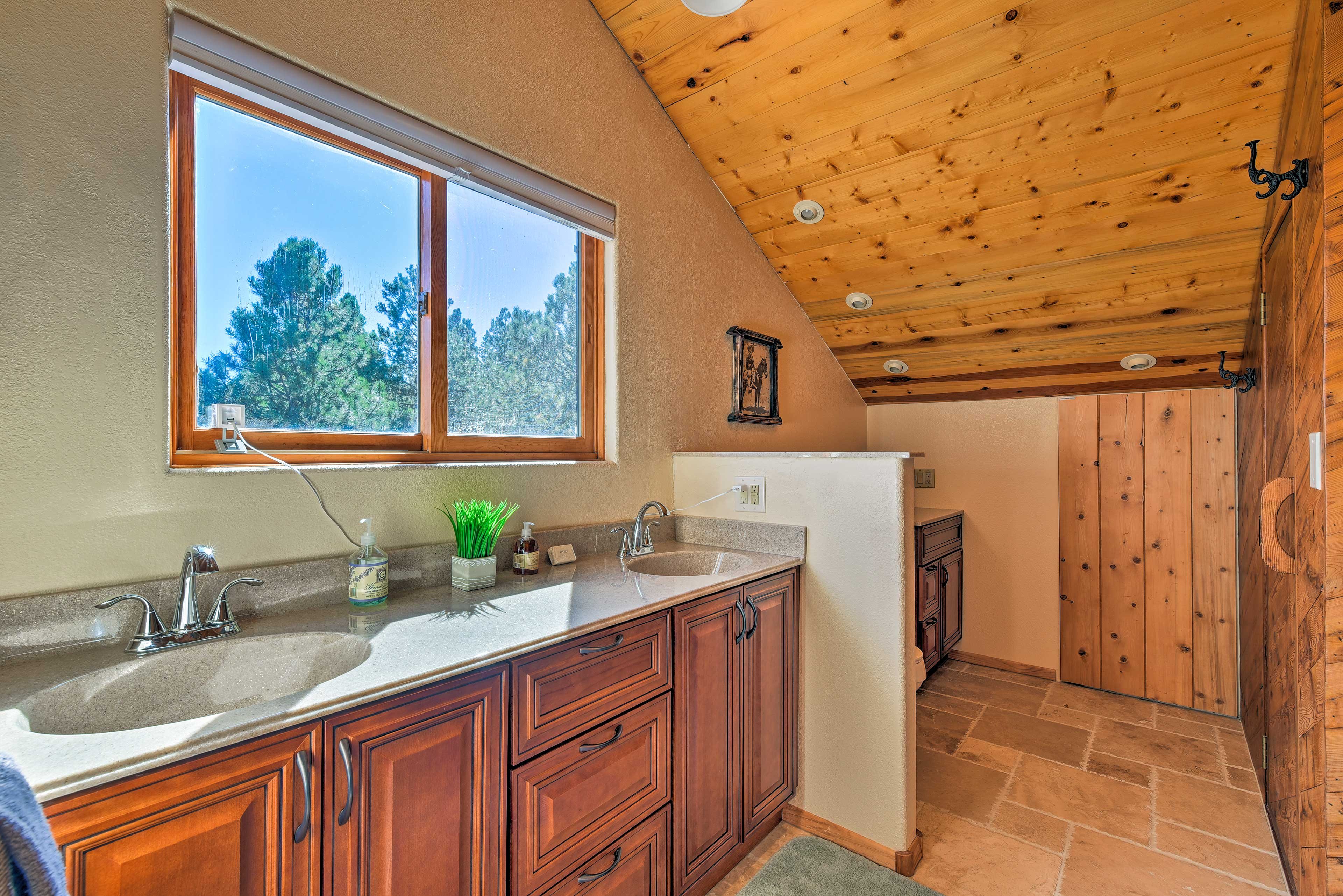 The master bathroom boasts a spacious shower and double sinks.