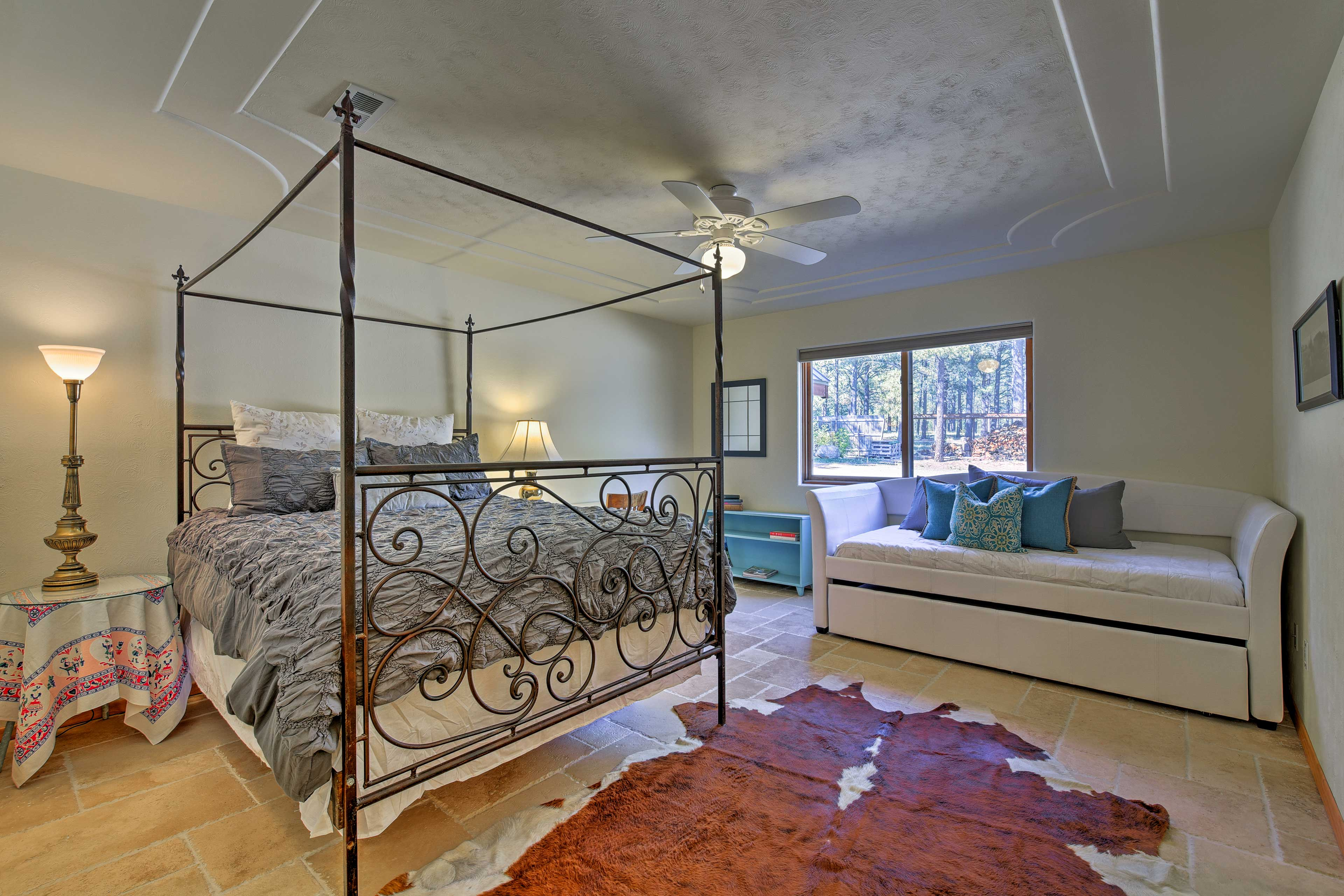 Curl up in the wrought iron queen bed for a restful night's sleep.