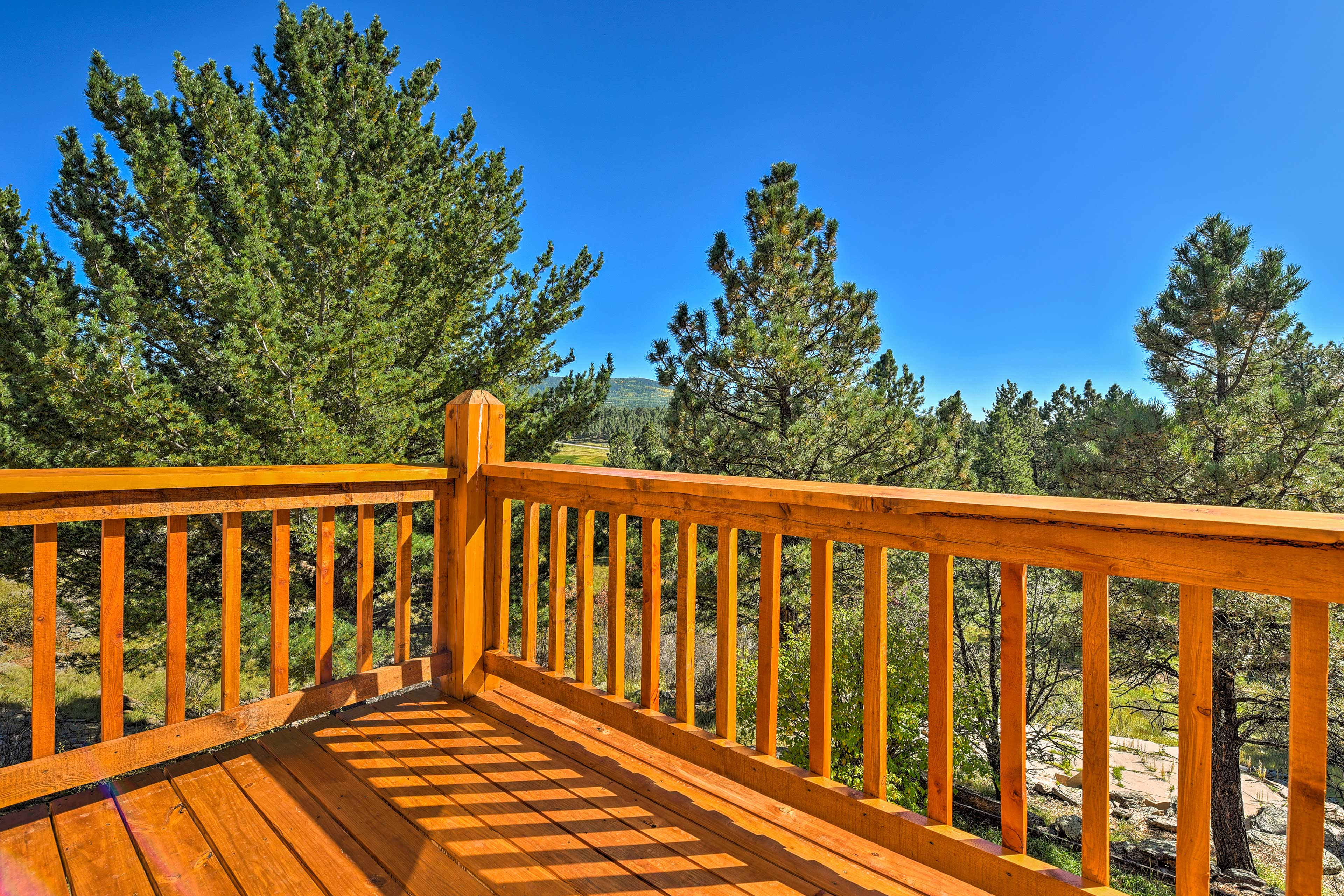 Step out to your private balcony to take in the mountain views.