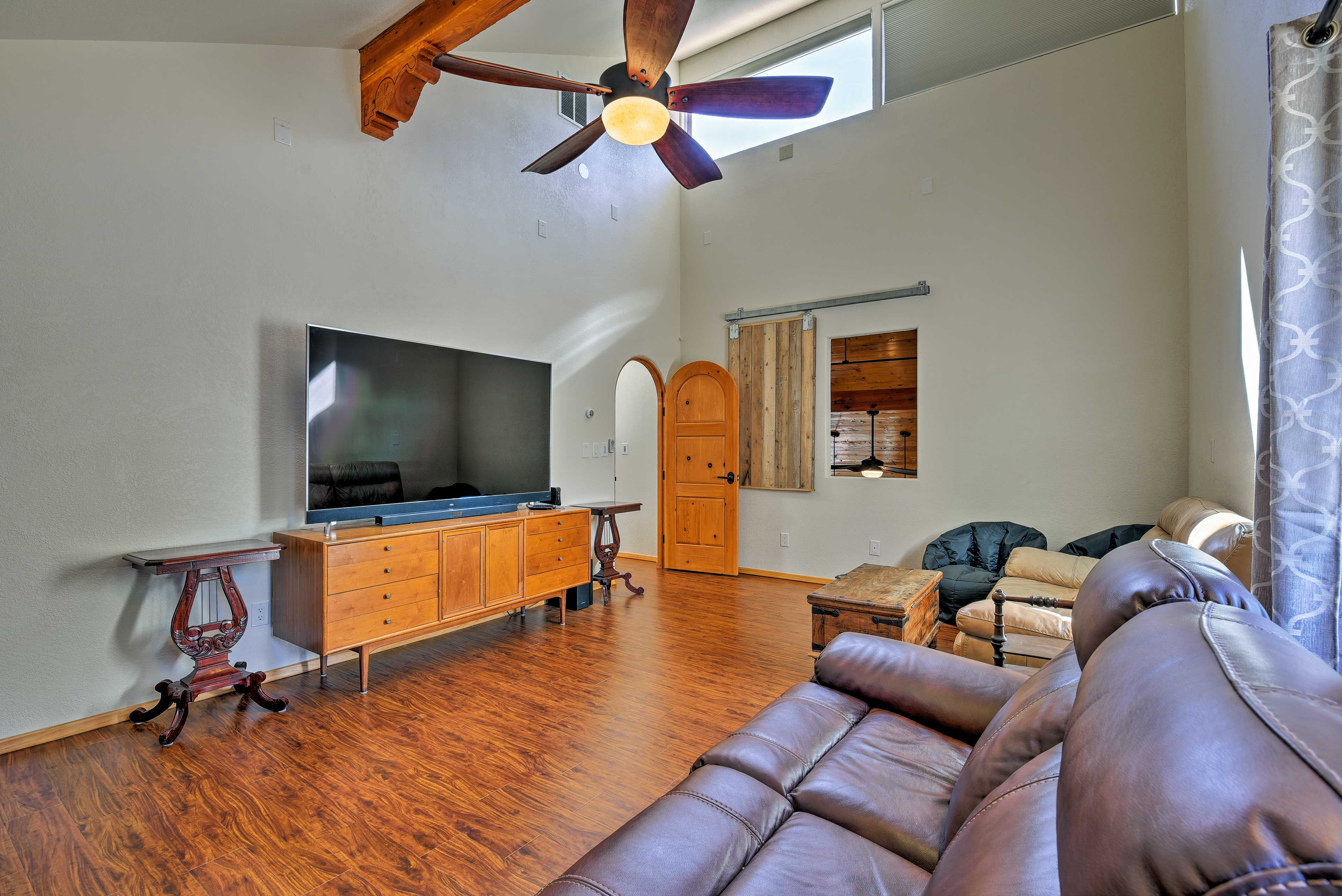 This bedroom offer a 72-inch flat-screen satellite TV with plush seating.