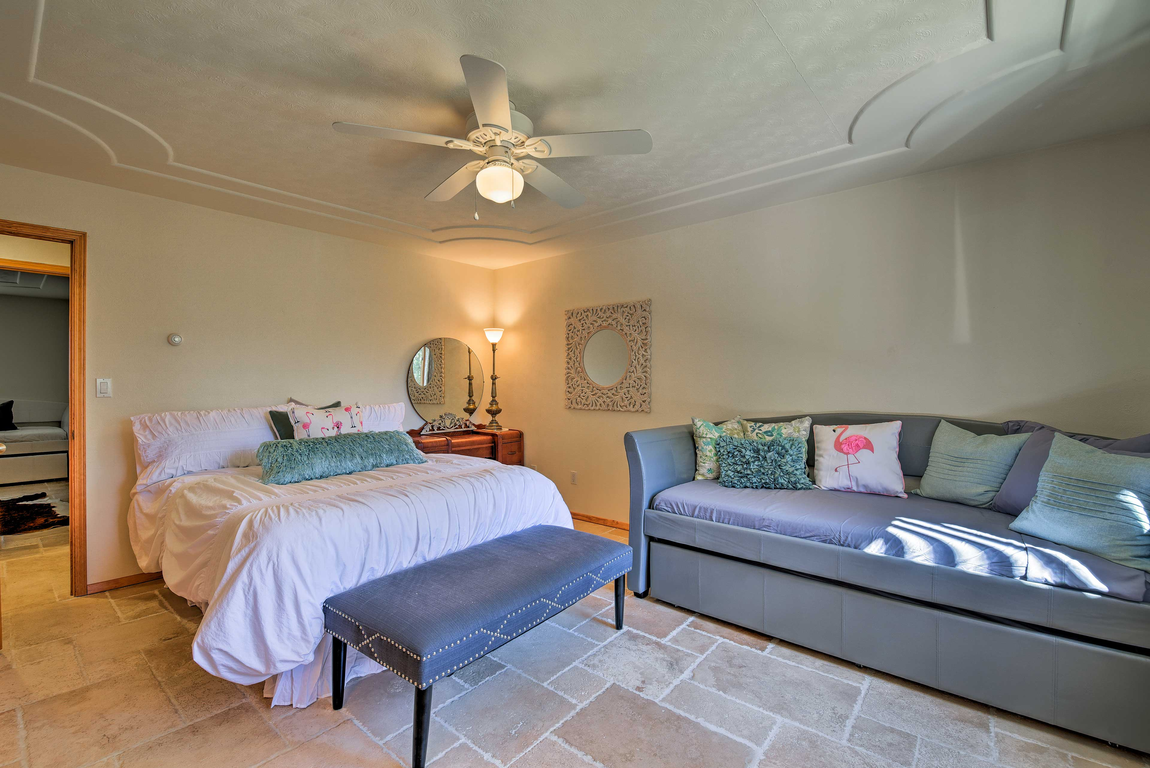 This third bedroom features a queen bed and chic modern decor.