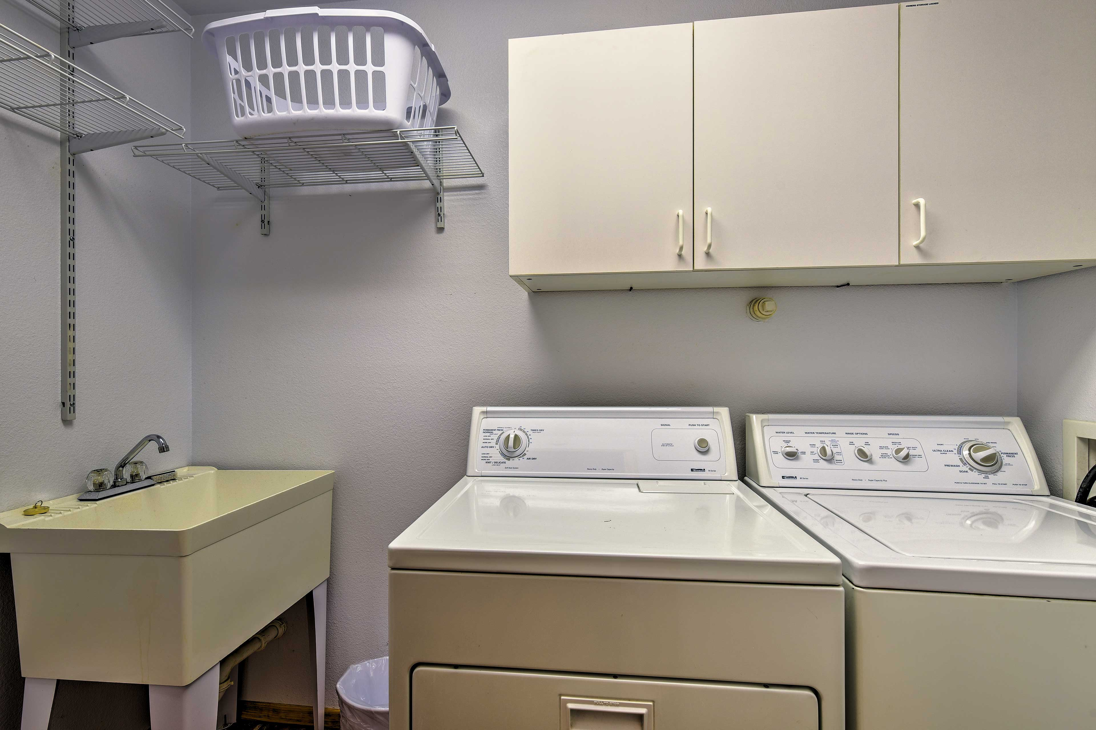 The bathroom also includes a the laundry room with a washer and dryer.