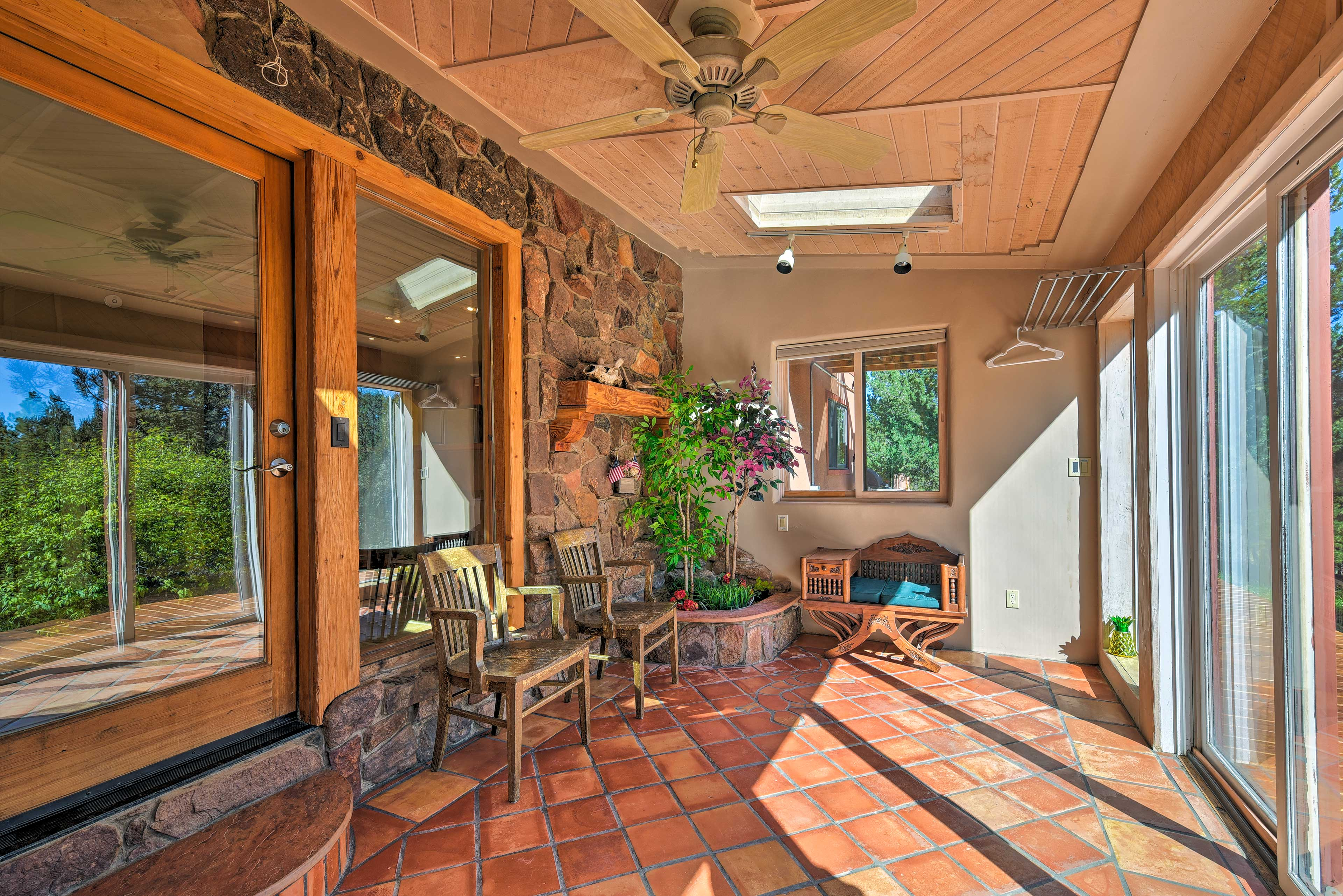 Take a seat in the sunroom to watch the neighboring wildlife meandering by.