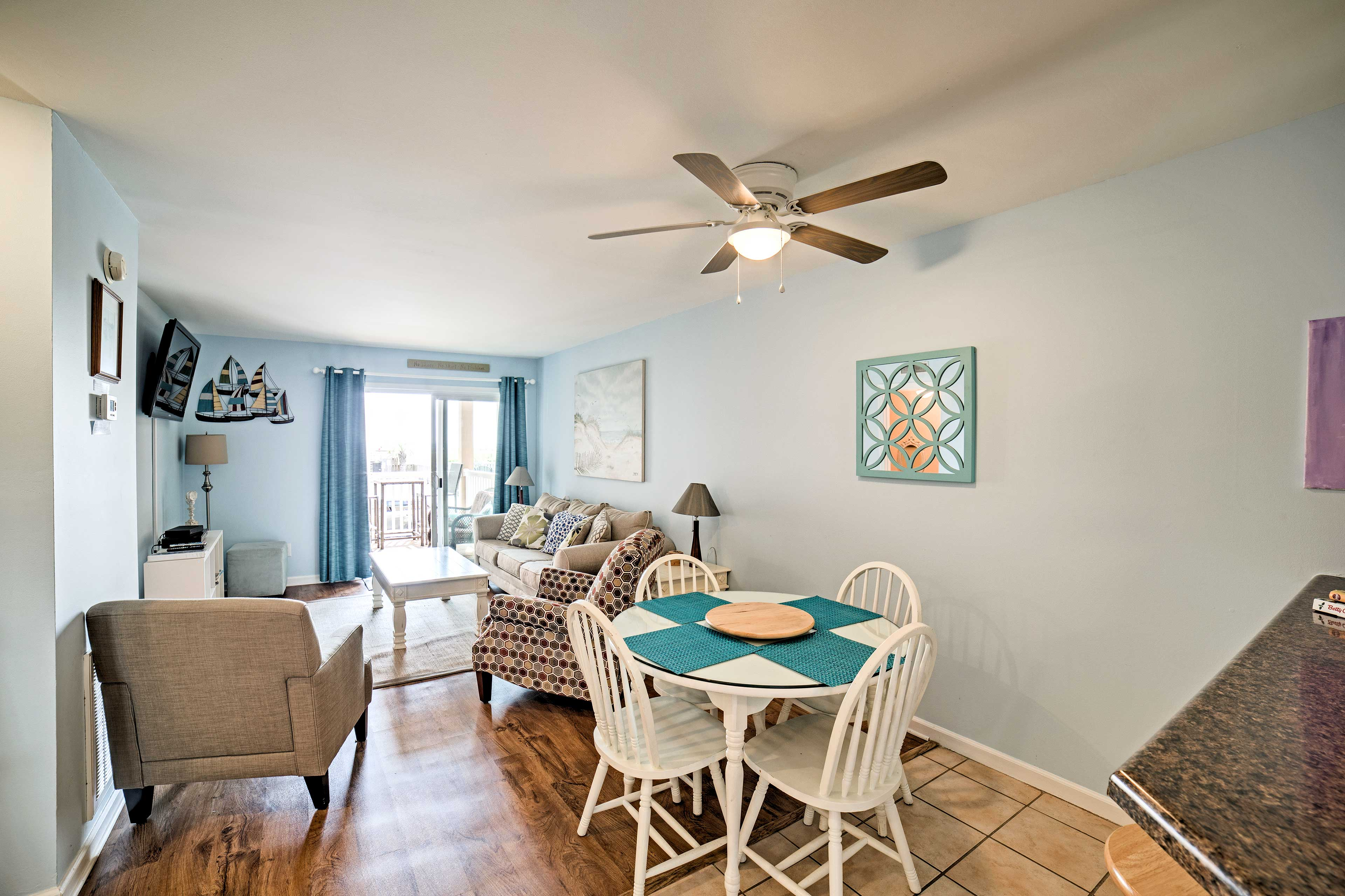 Natural light illuminates the room, complete with a 4-person dining table.