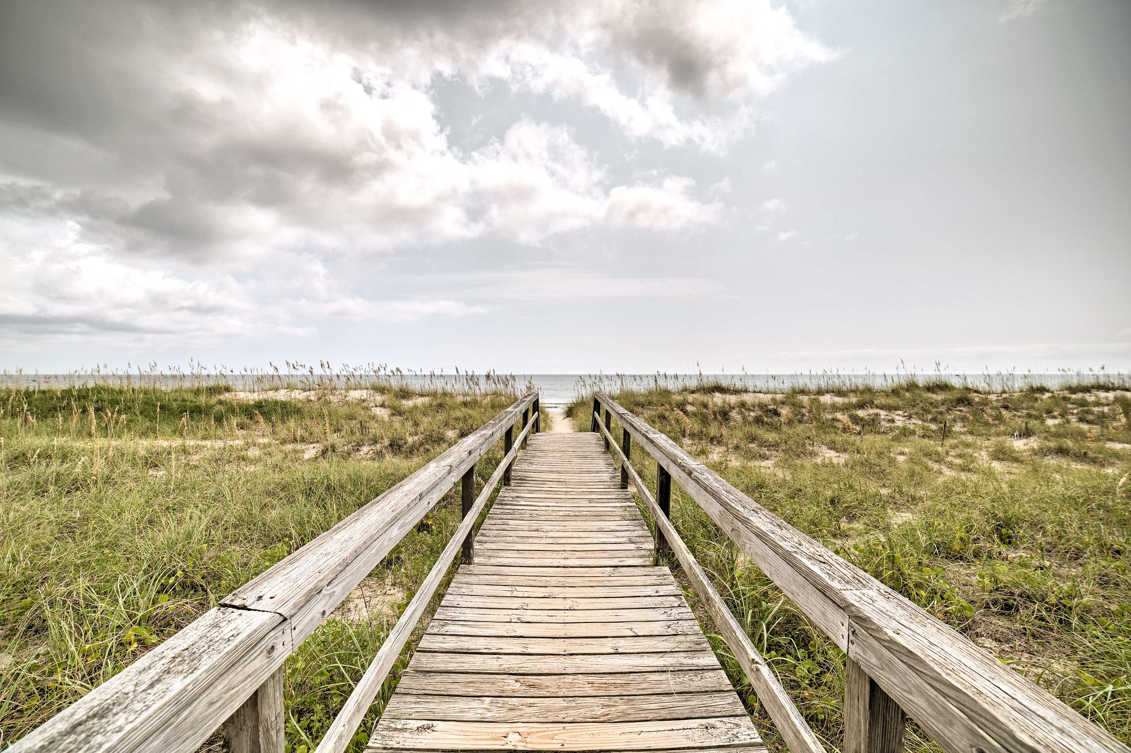 Carolina Beach is just a short boardwalk from this 2-bed, 2-bath unit for 7.