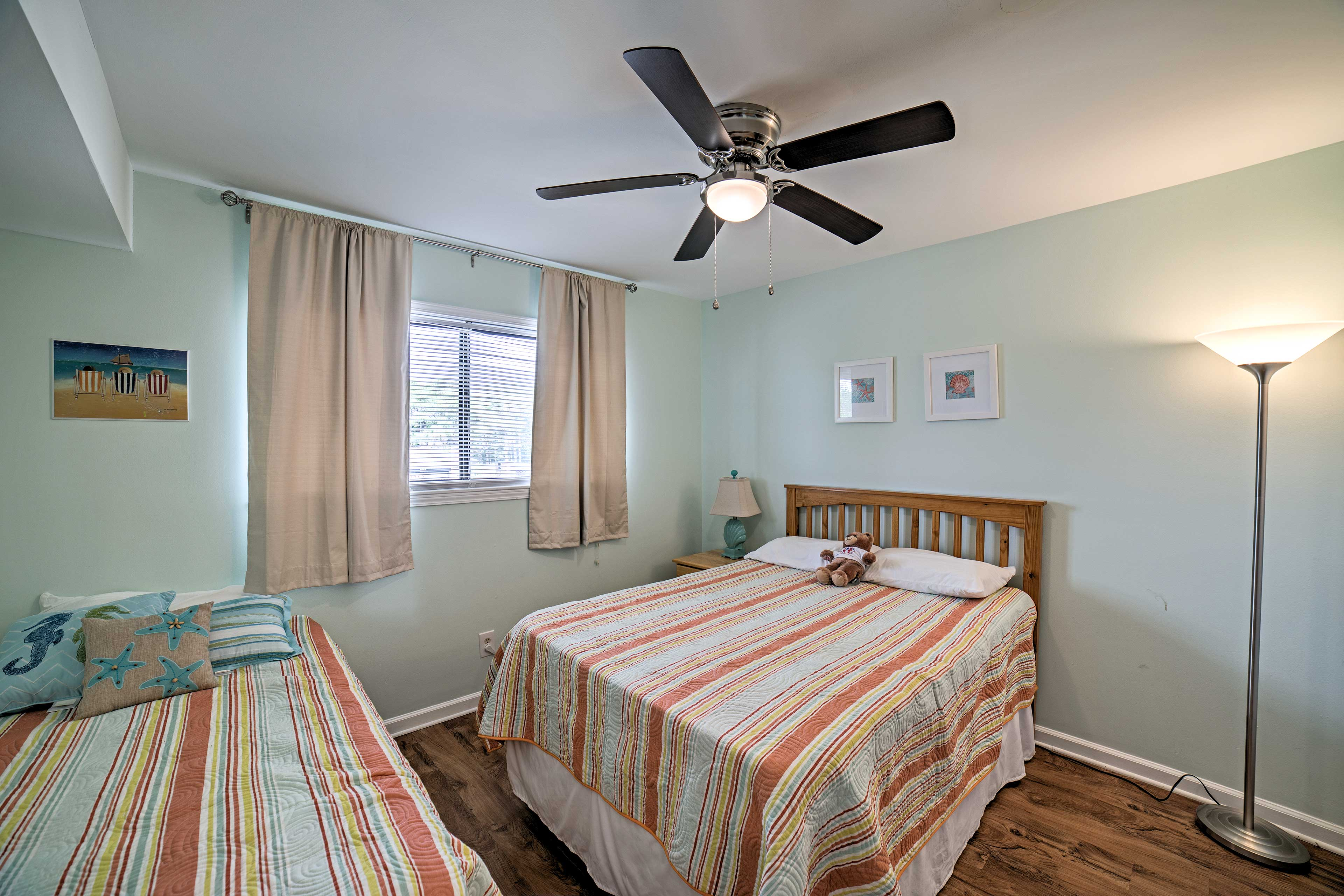 The second bedroom easily sleeps up to 3 guests in full and twin bed.